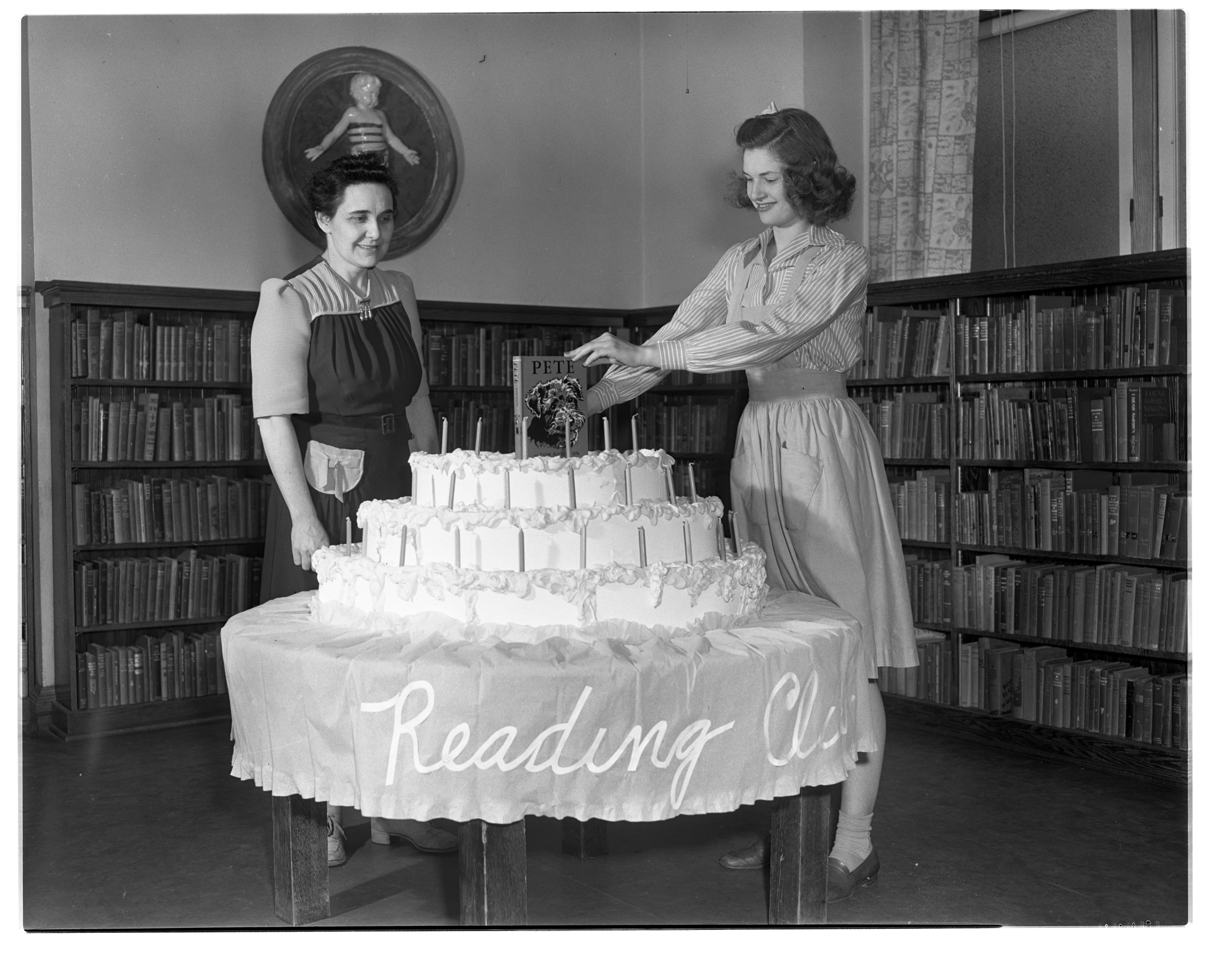 Hazel Keedle & Joan Gallup With Summer Vacation Reading Club Birthday Cake, Ann Arbor Public Library, June 1941 image