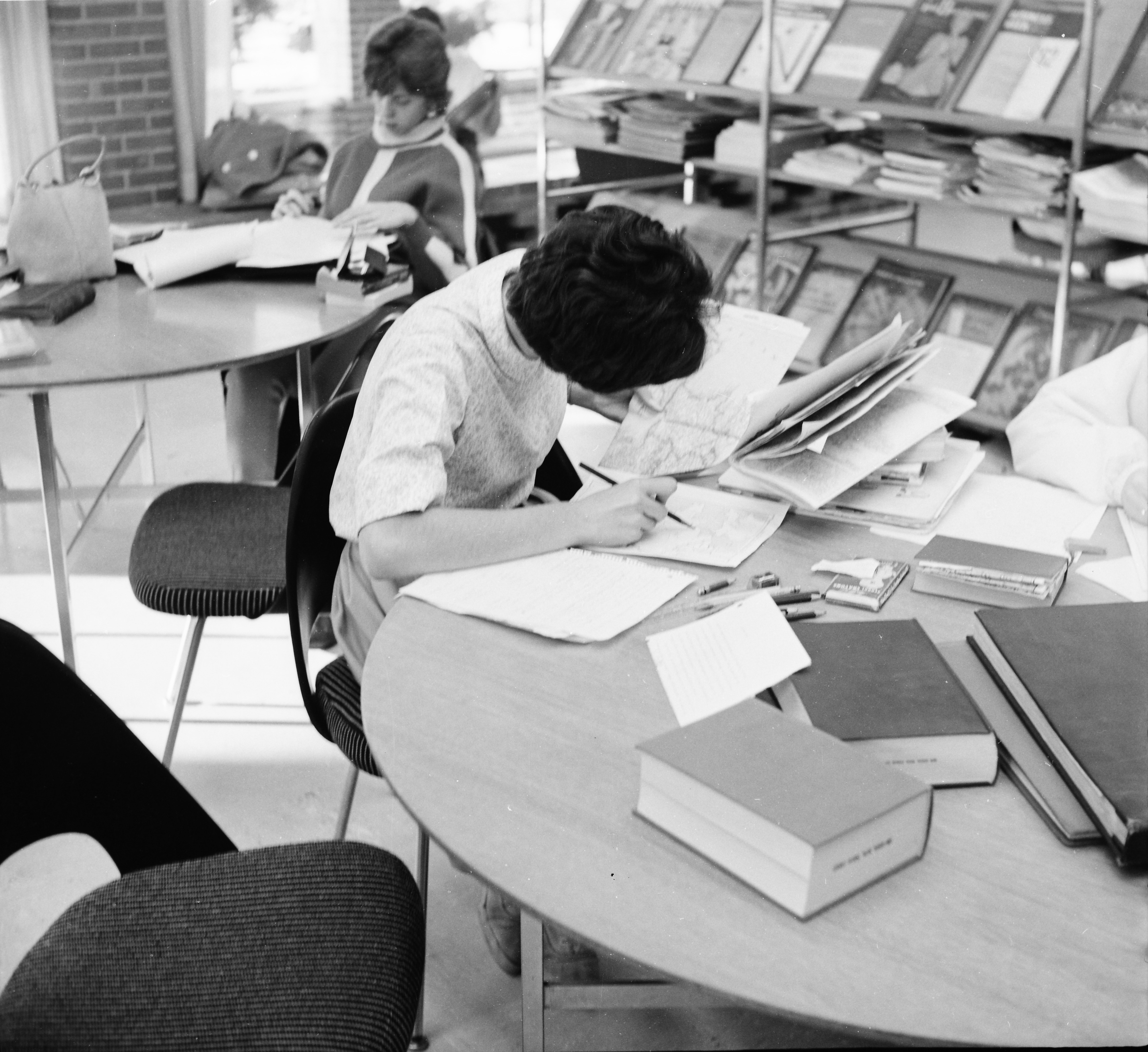 Studying Maps During the Holidays at the Ann Arbor Public Library, December 1961 image