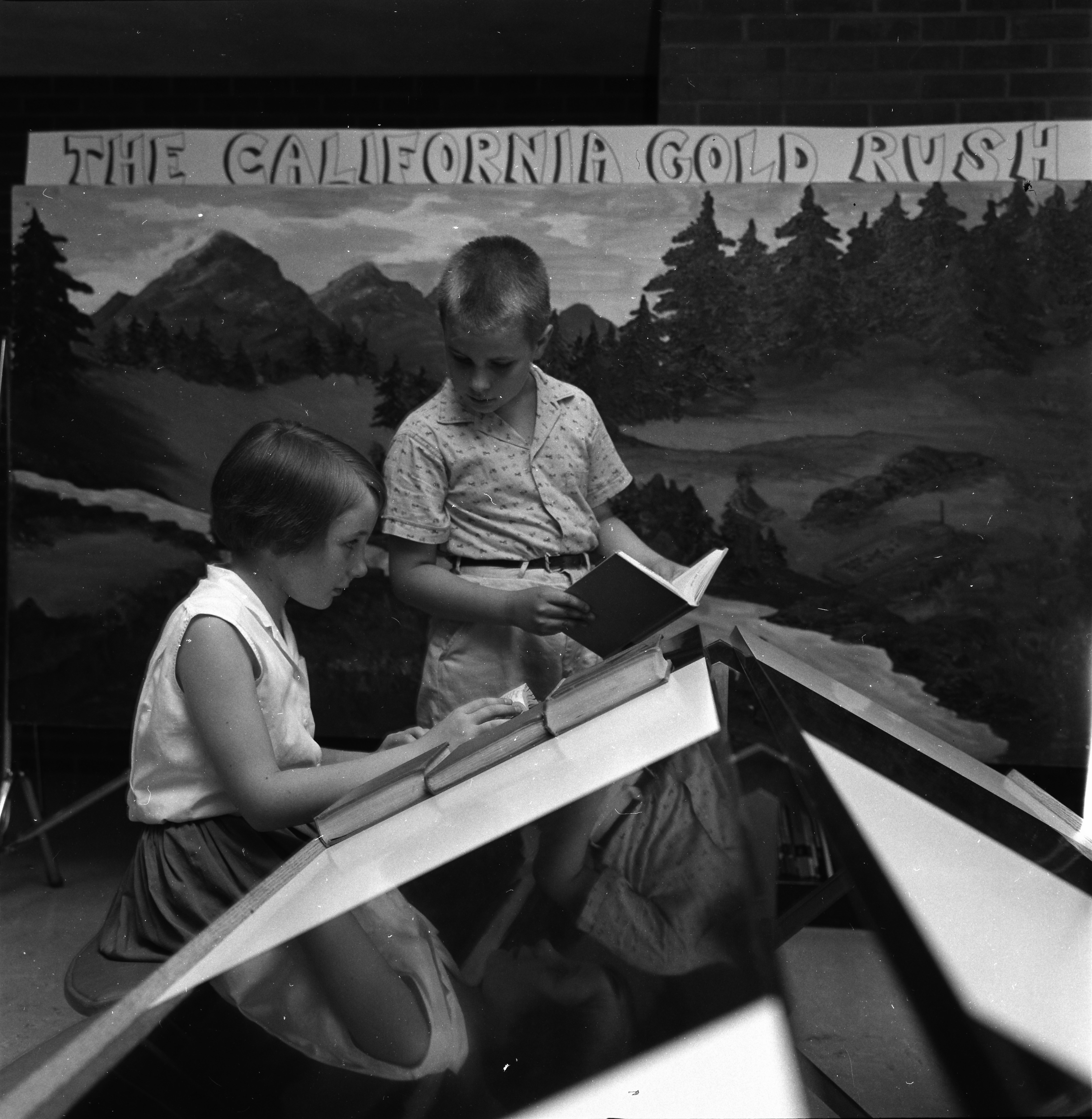 "Ellen and Andrew Bishop Pick Books for the Ann Arbor Public Library Summer Reading Club, ""The California Gold Rush,"" June 1963 image"