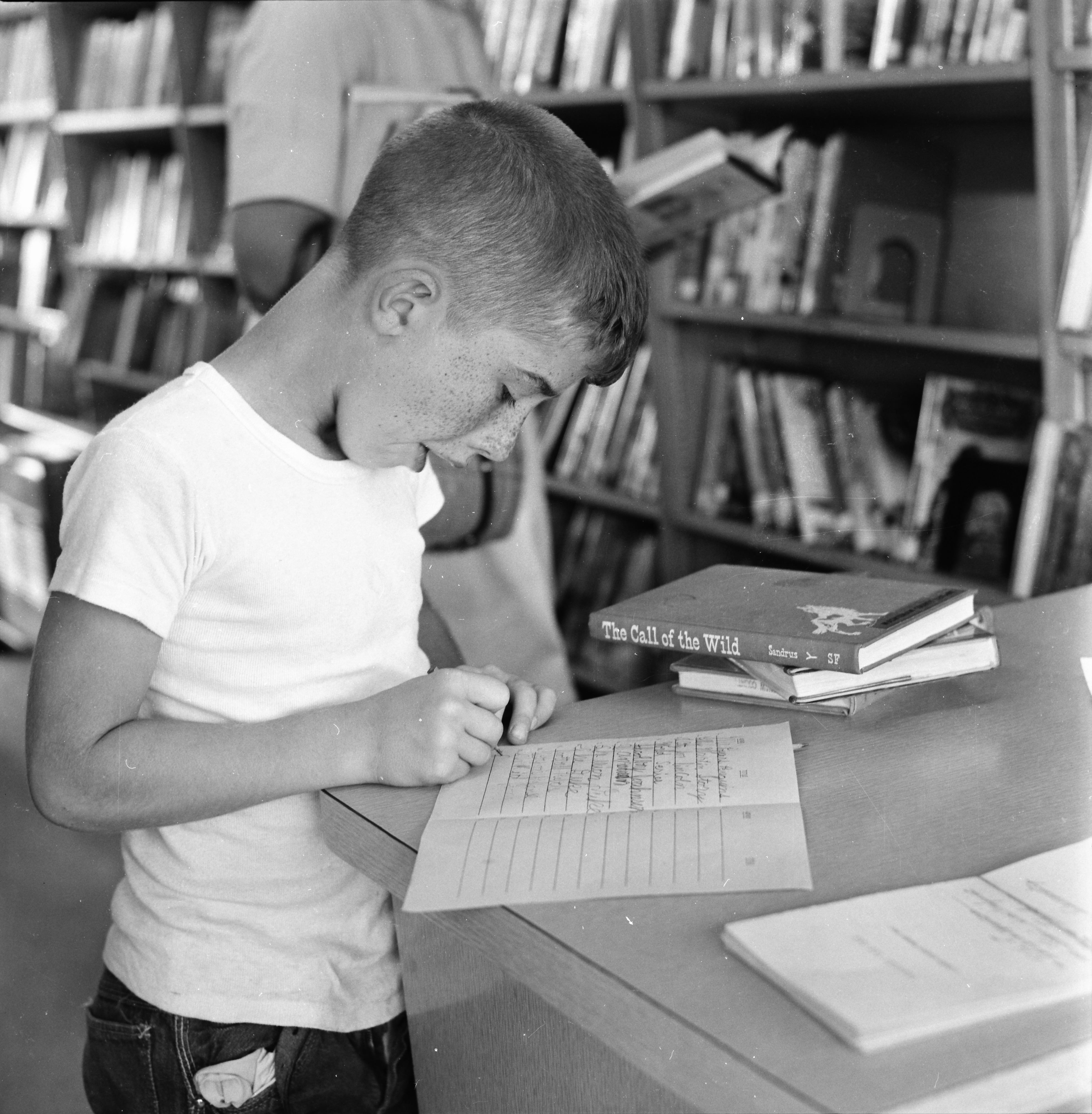 Peter Tyrant Record His Summer Reading In the Washtenaw County Library Bookmobile, July 1963 image