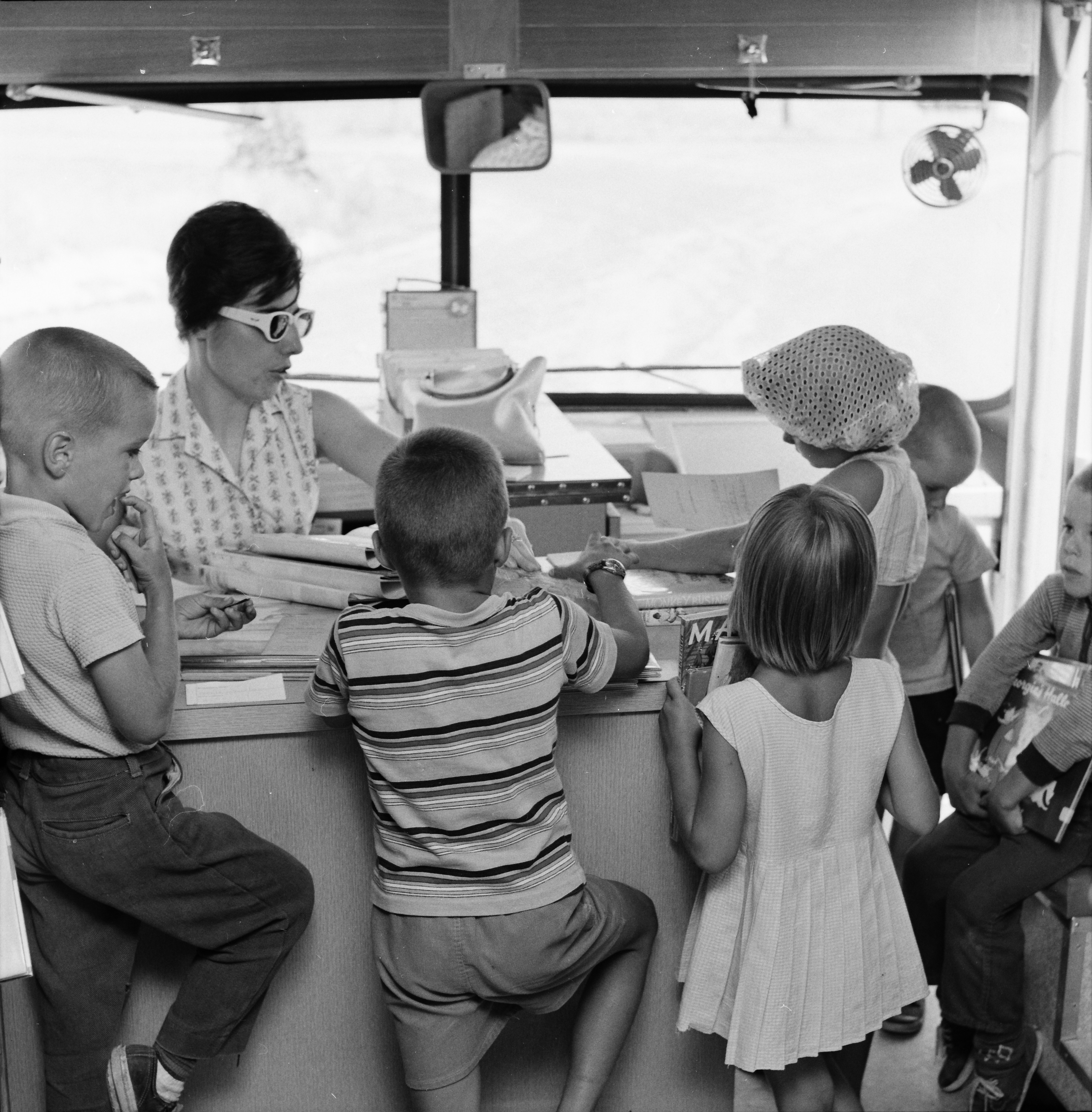 Check-Out Desk In the Washtenaw County Library Bookmobile, July 1963 image
