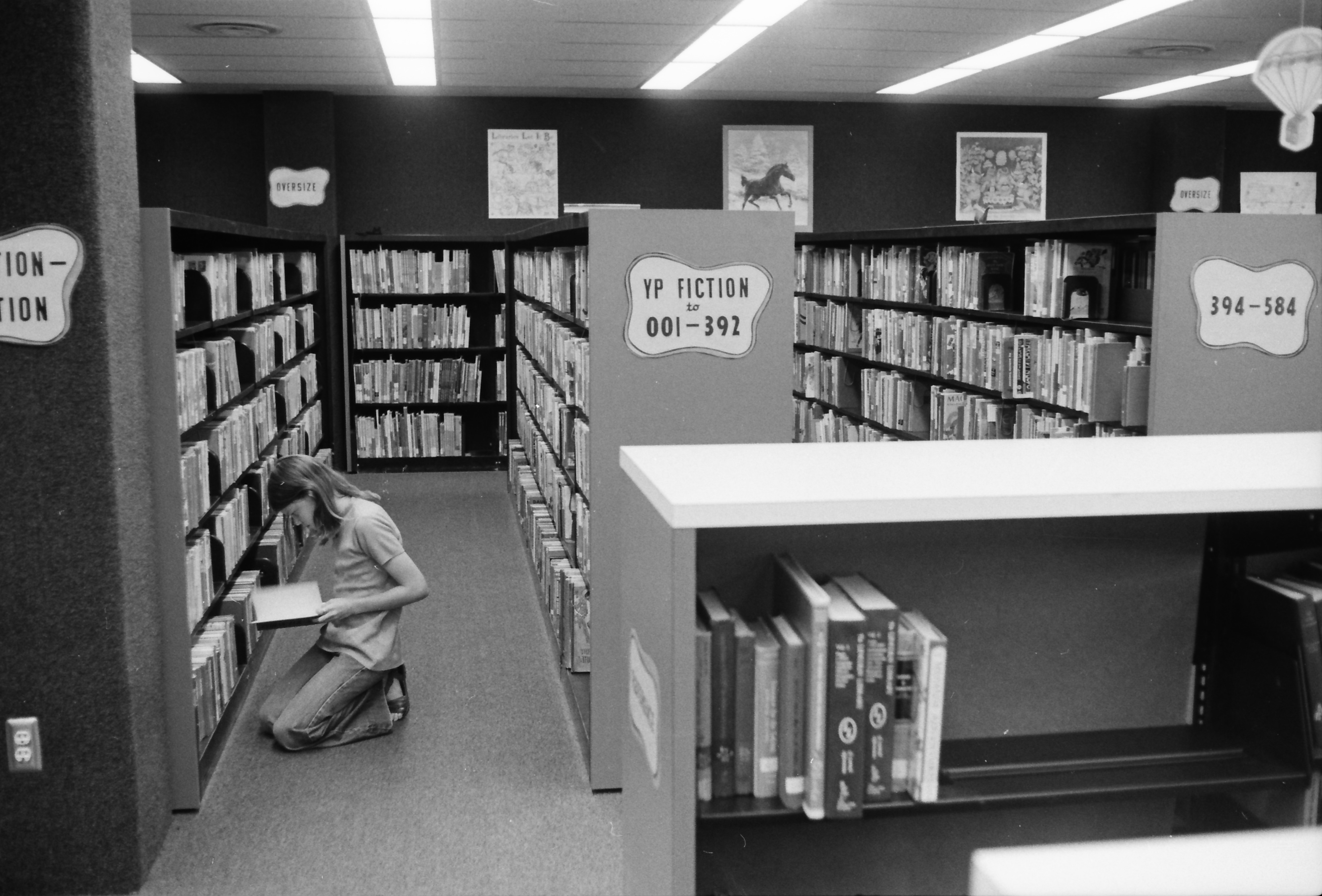 Kathy Brewer Browsing a Book in the Children's Department in the New Addition at the Ann Arbor Public Library, 343 S Fifth Ave, July 1974 image