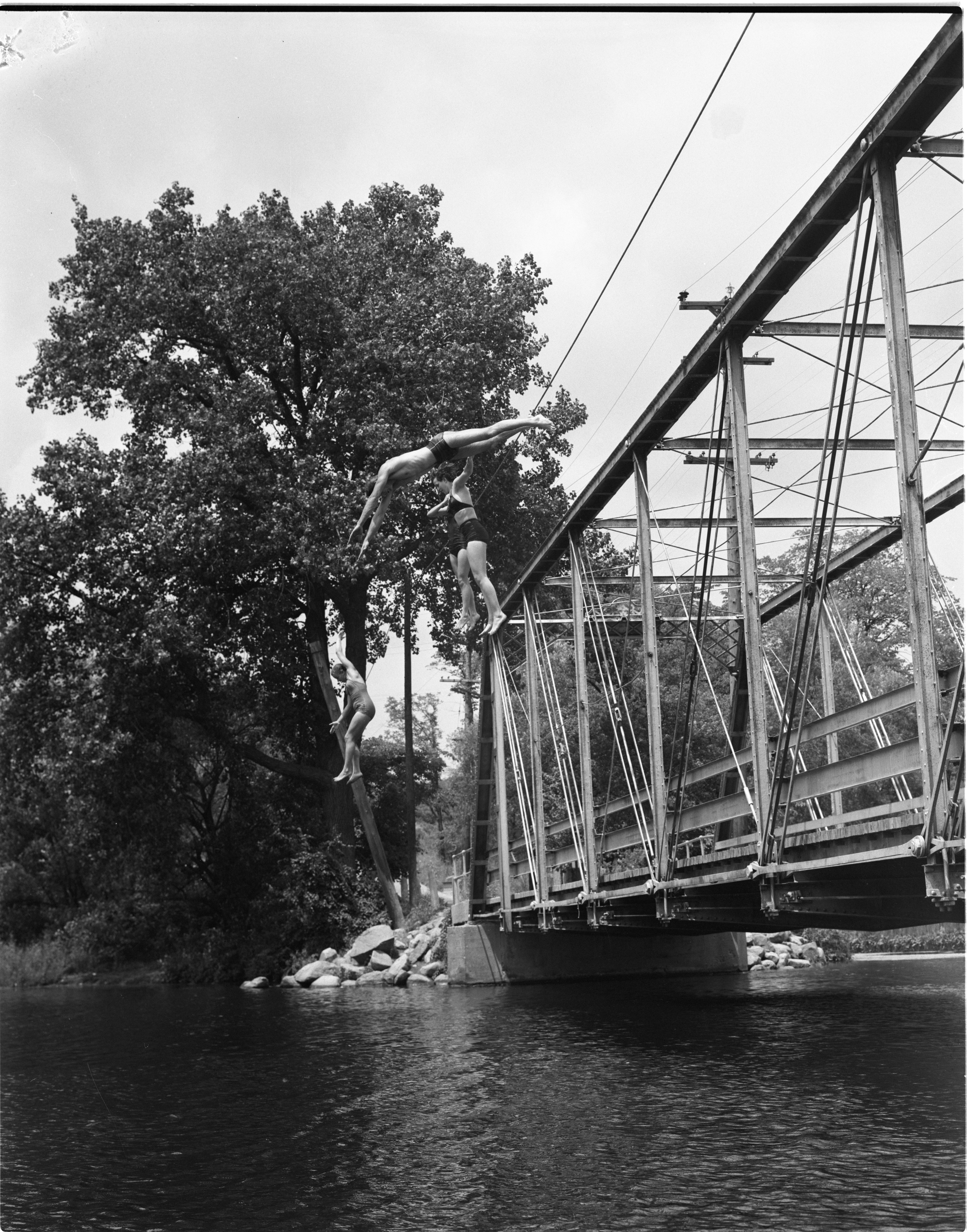 Swimmers Jump Off The Foster Bridge, July 1955 image