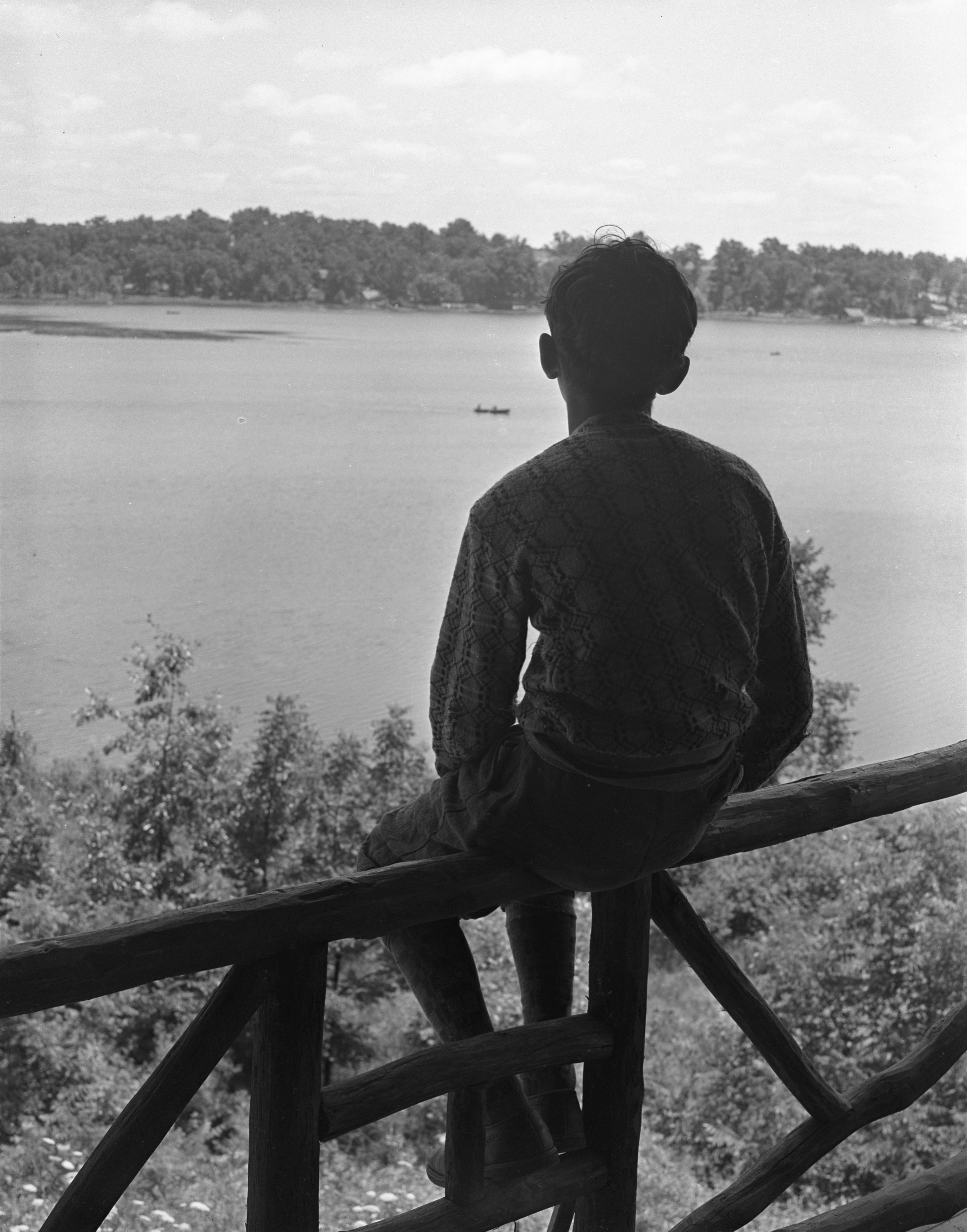 A Camper Looks Out At Patterson Lake At The University Of Michigan's Fresh Air Camp, July 1939 image