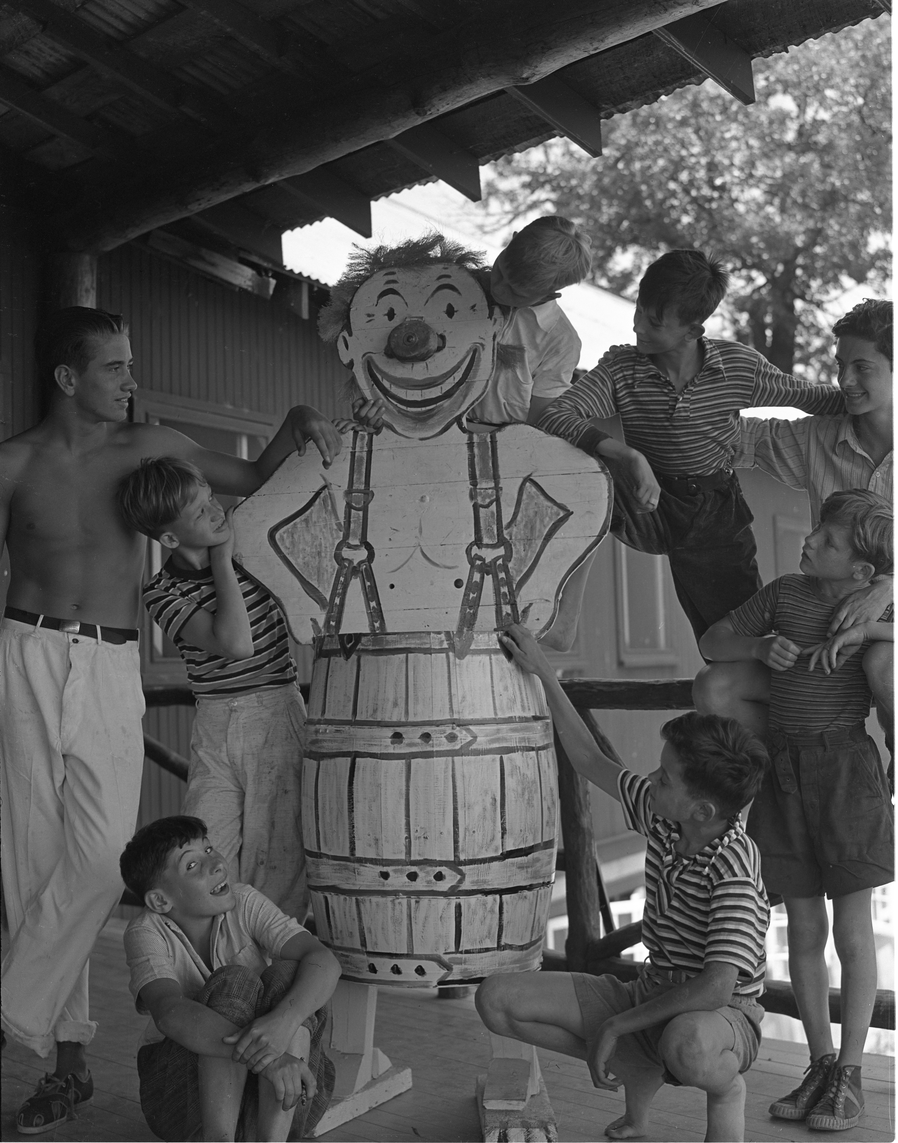 Campers At The University Of Michigan's Fresh Air Camp Pose With Wooden Clown, July 1939 image
