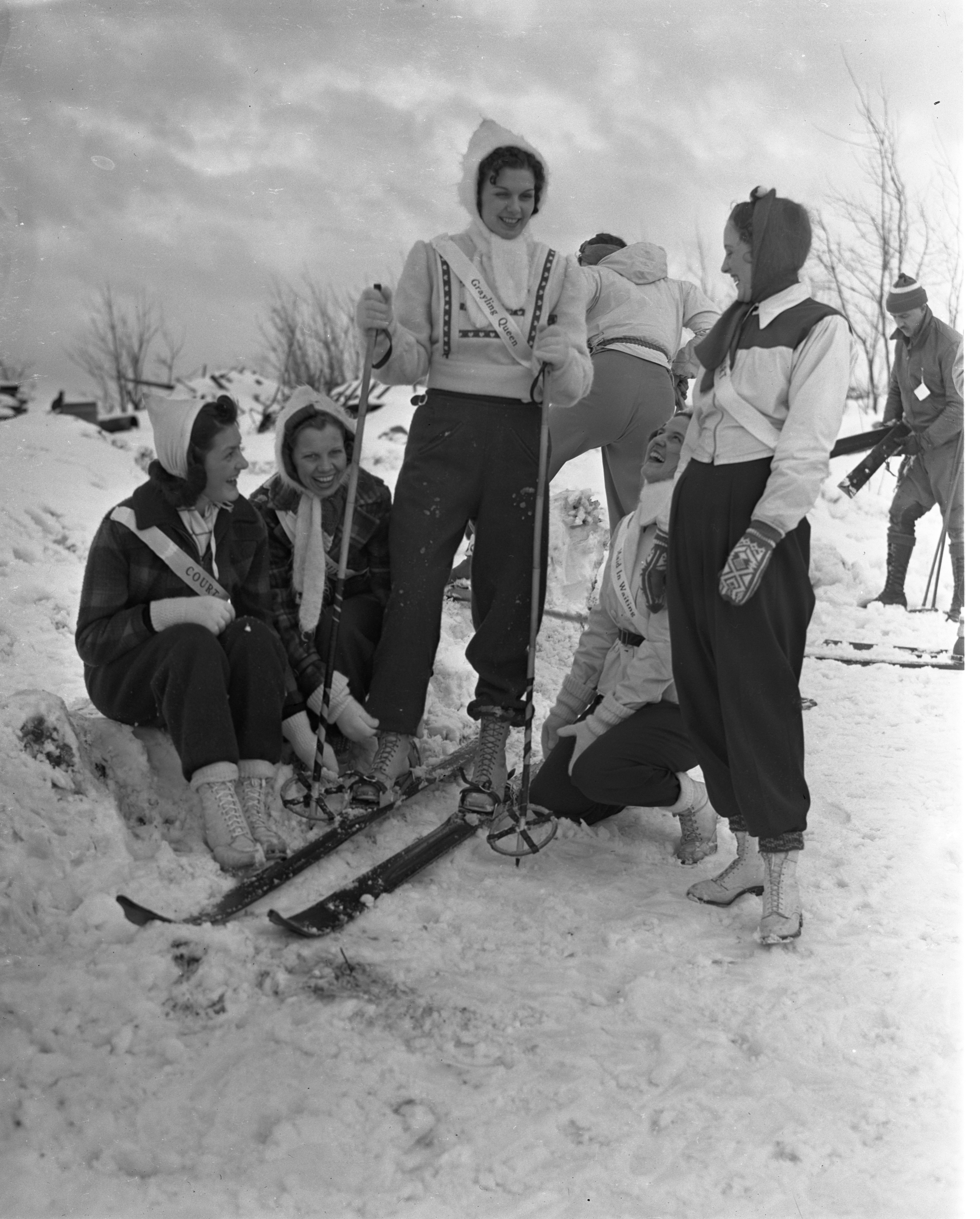 Grayling Snow Queen Pauline Merrill On Skis Surrounded By Her Court, January 1940 image