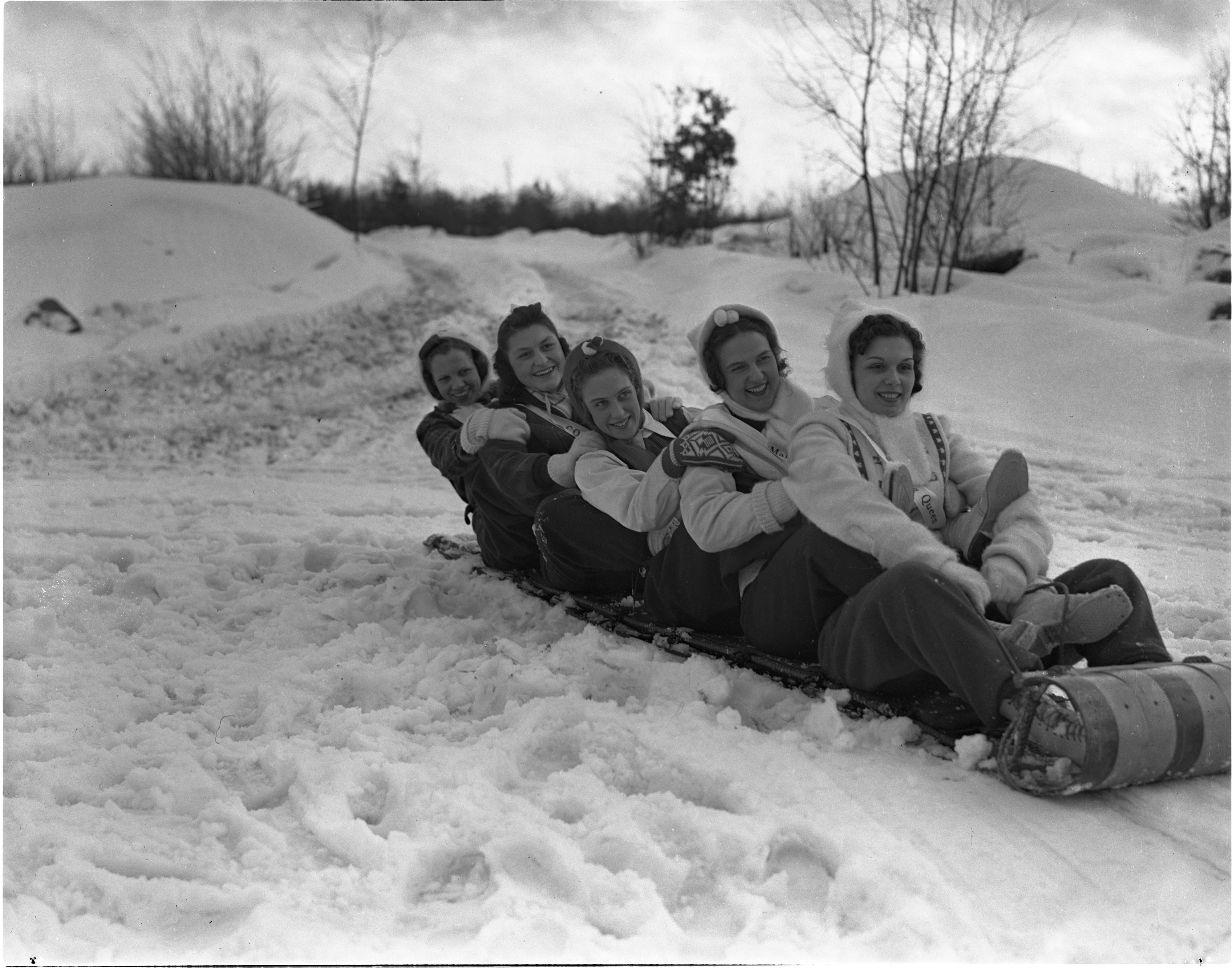 Grayling Snow Queen Pauline Merrill And Her Court On A Toboggan, January 1940 image