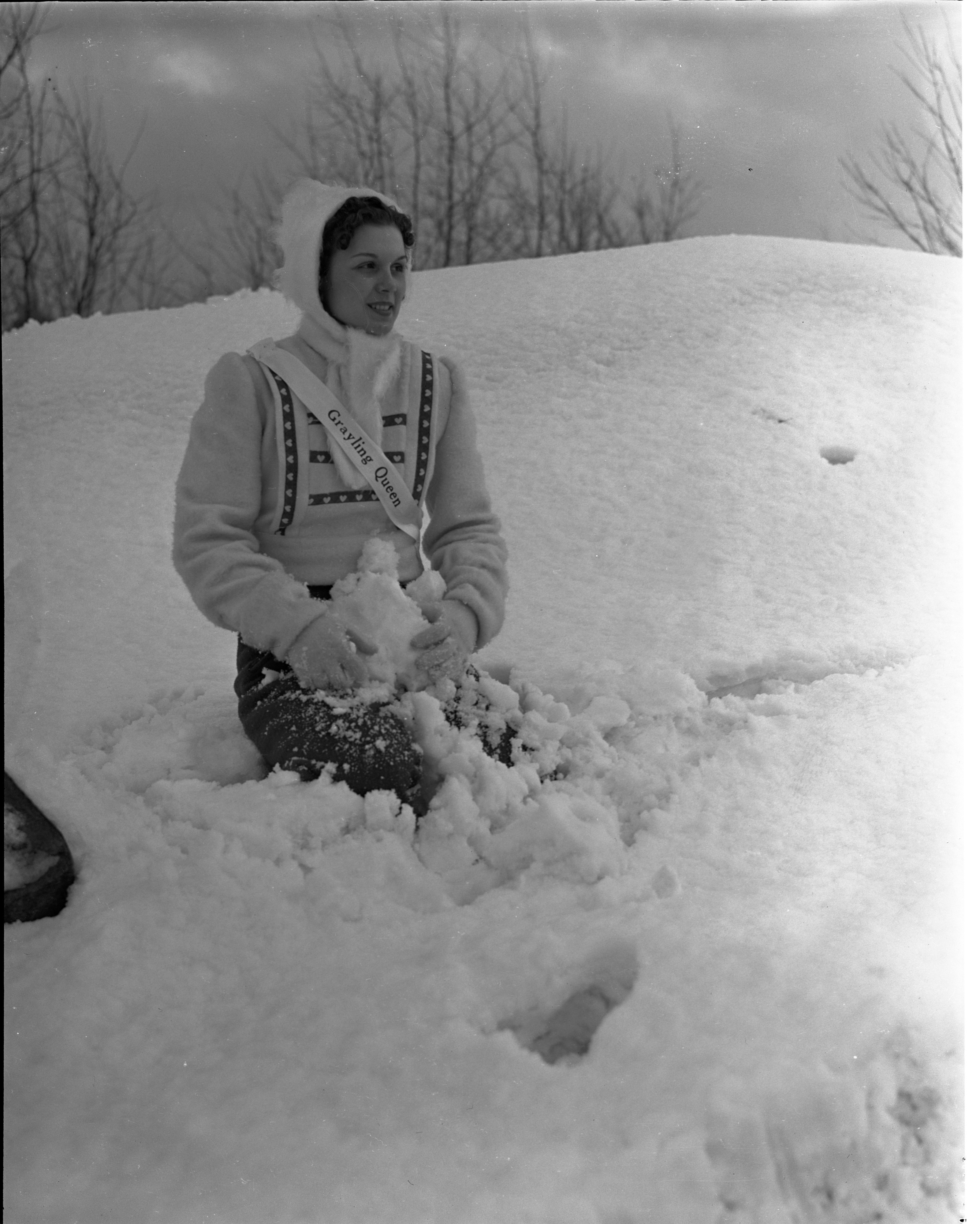 Grayling Snow Queen Pauline Merrill Sits In The Snow, January 1940 image