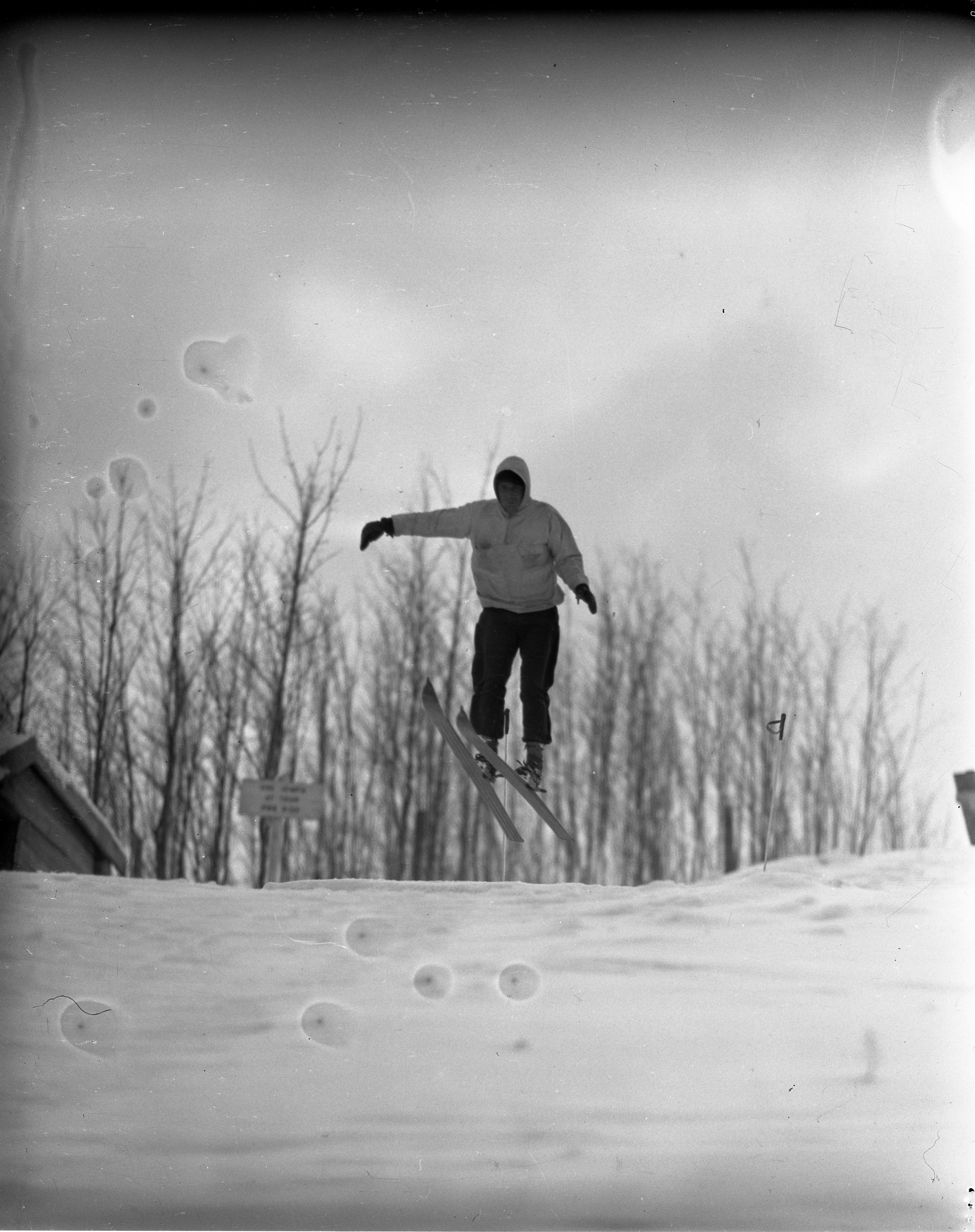Skier In Air At Caberfae, February 1940 image