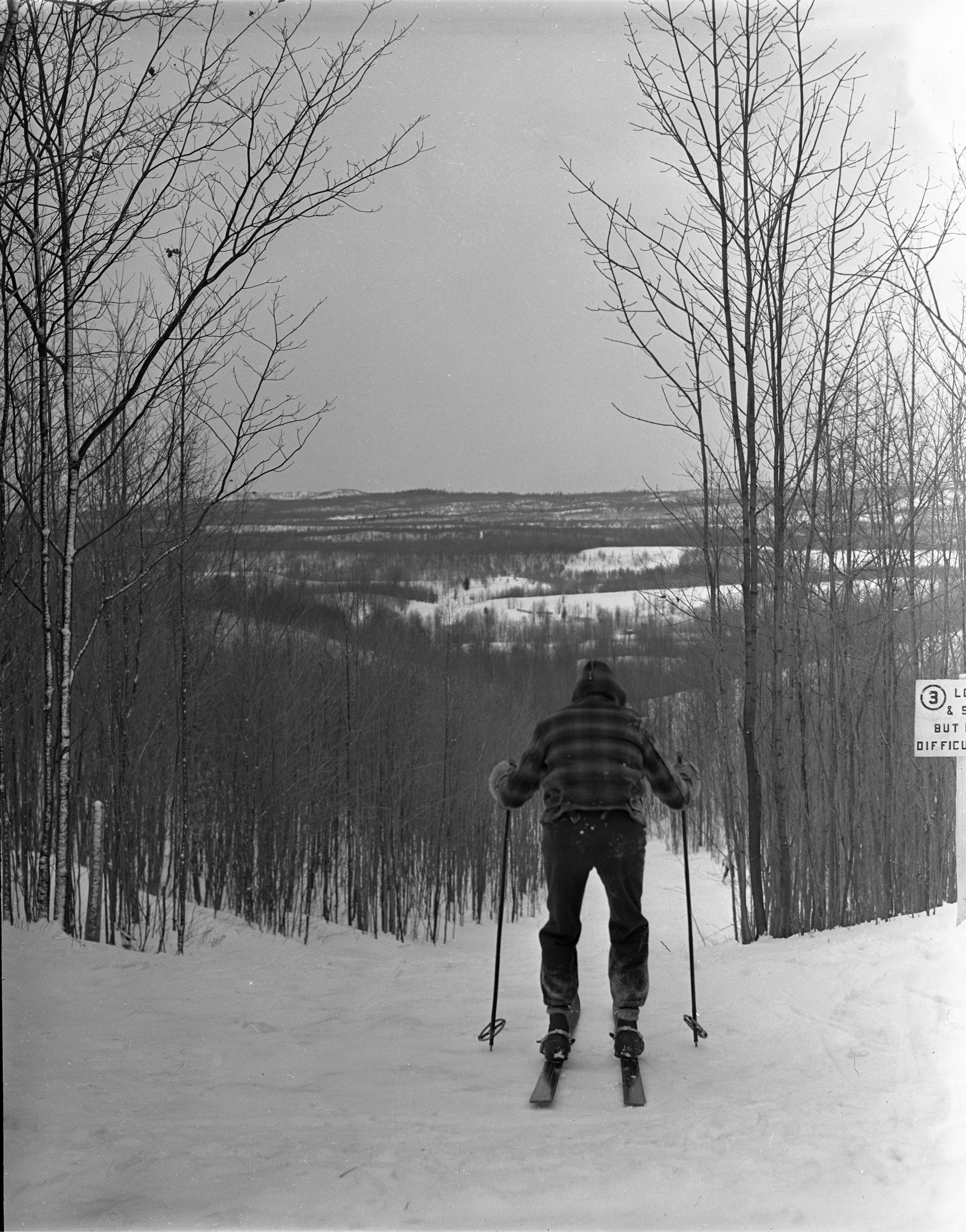 Skier Stands Atop Ski Run At Caberfae, February 1940 image