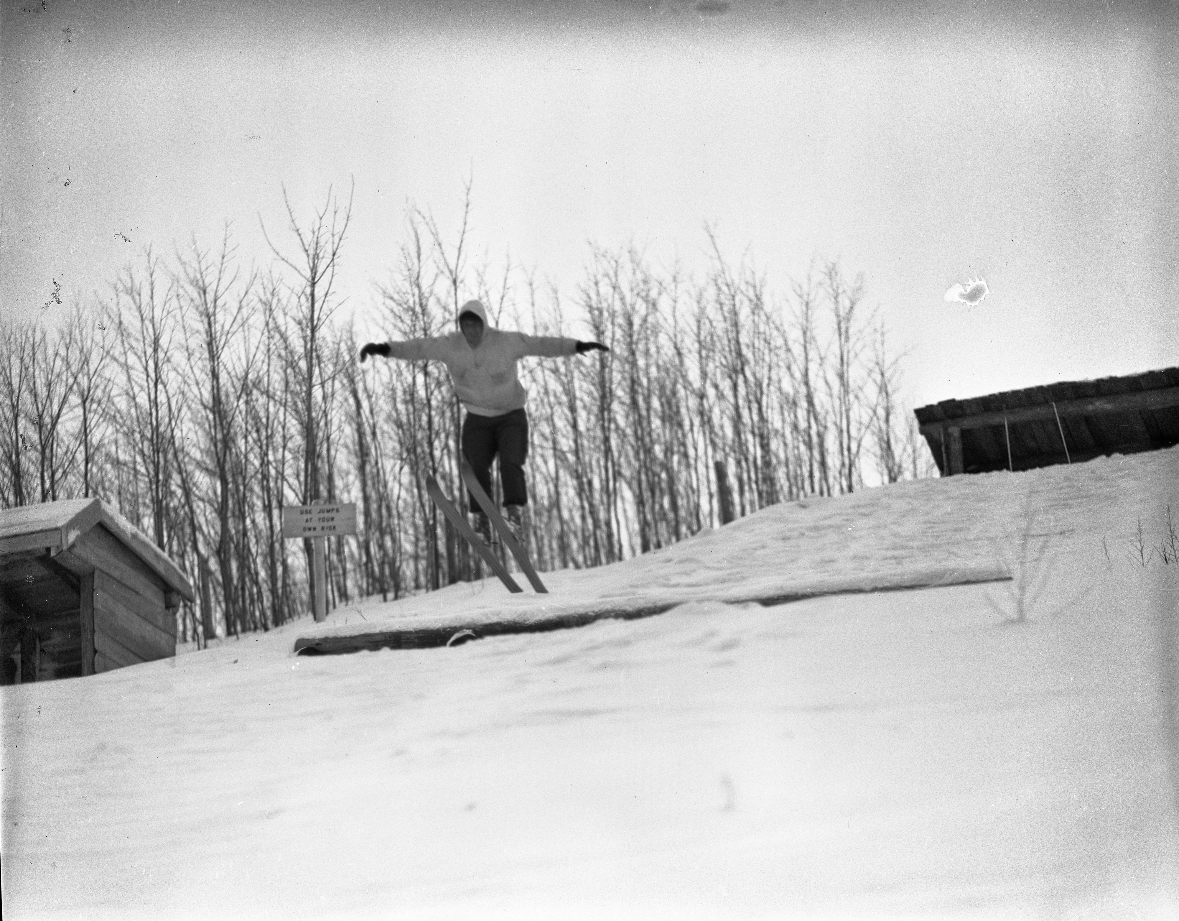 Skier In Air From Jump At Caberfae, February 1940 image