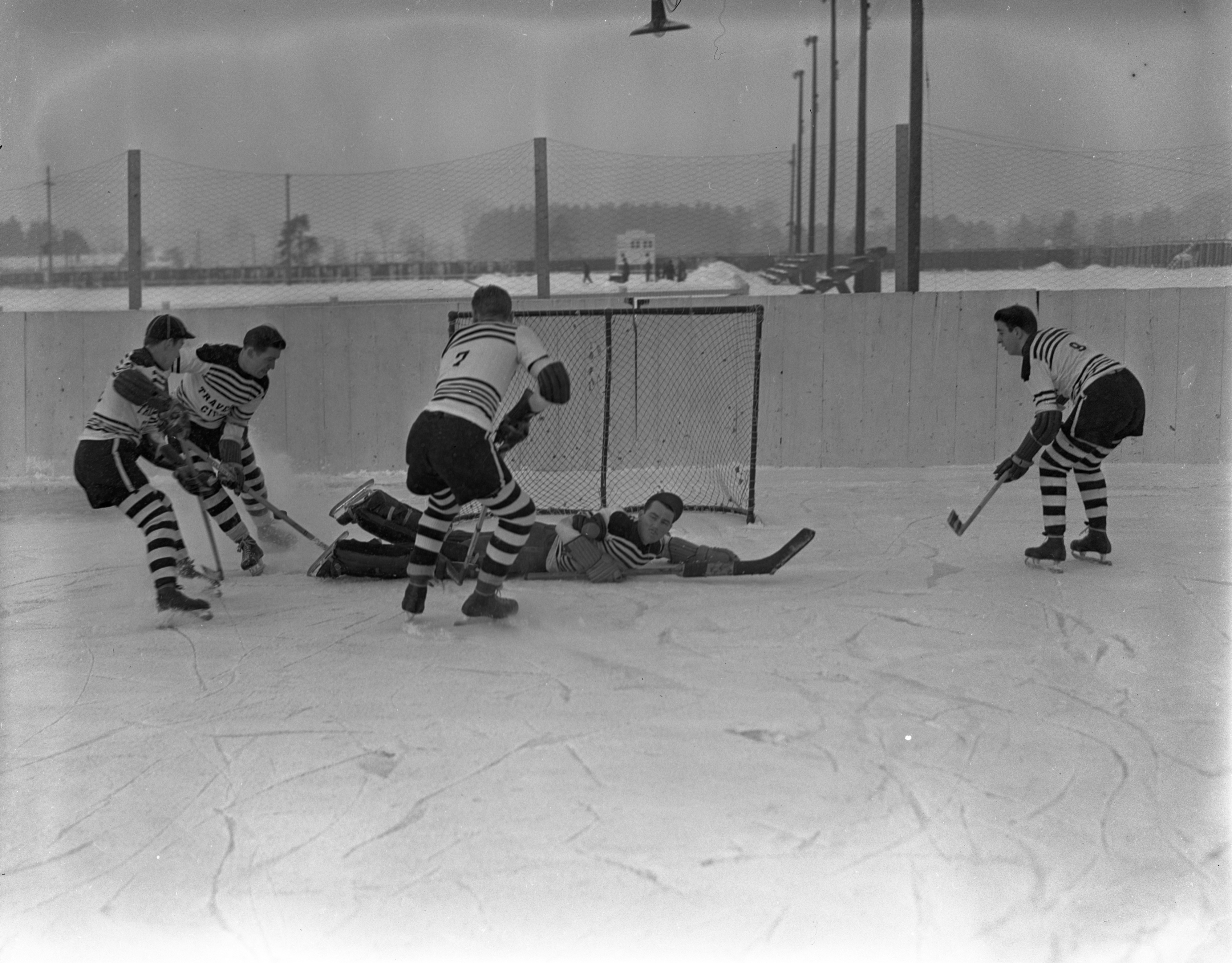 Playing Hockey On Outdoor Ice Rink In Traverse City, January 1940 image