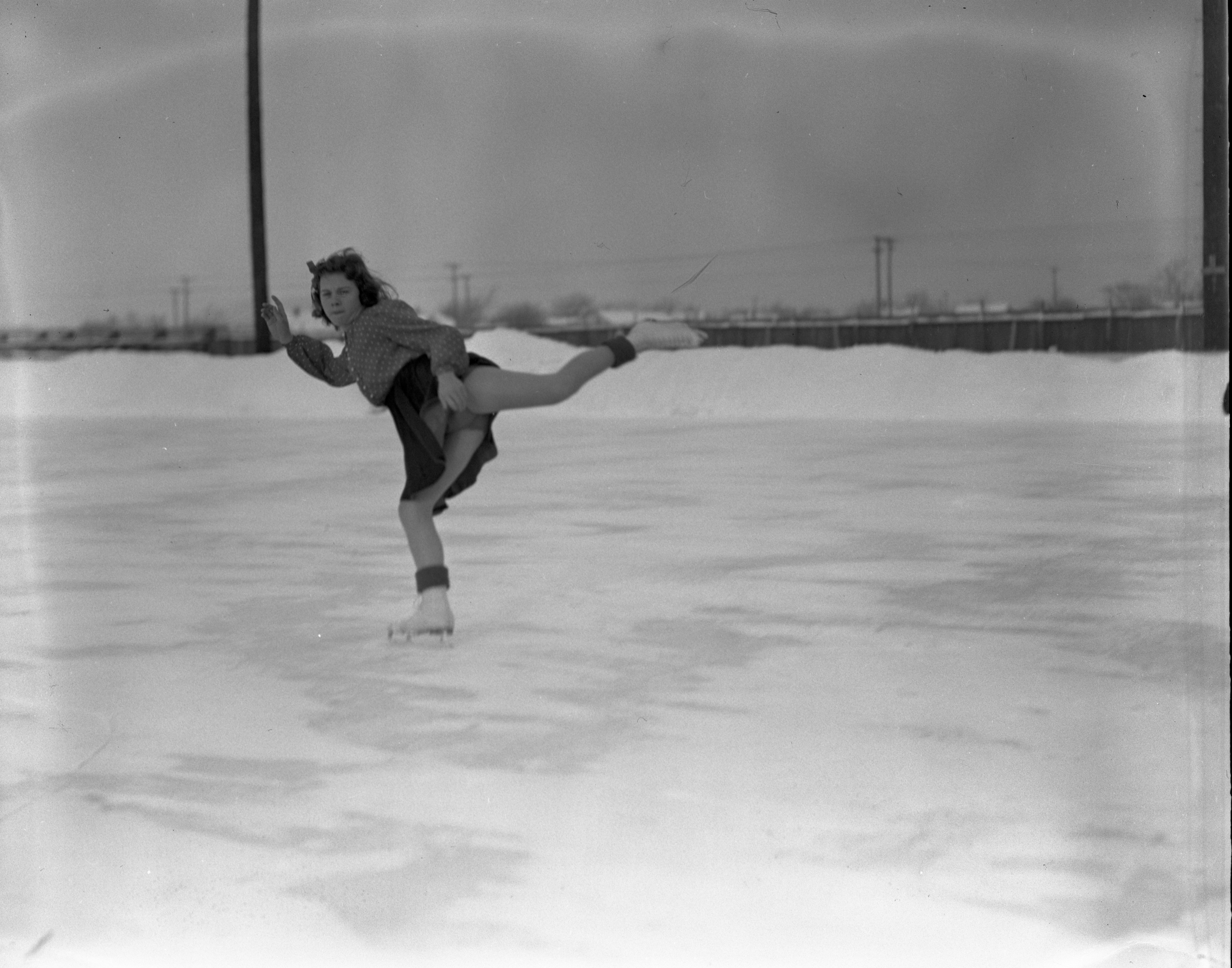 LaVerne Conant Figure Skates On Outdoor Ice Rink In Traverse City, January 1940 image