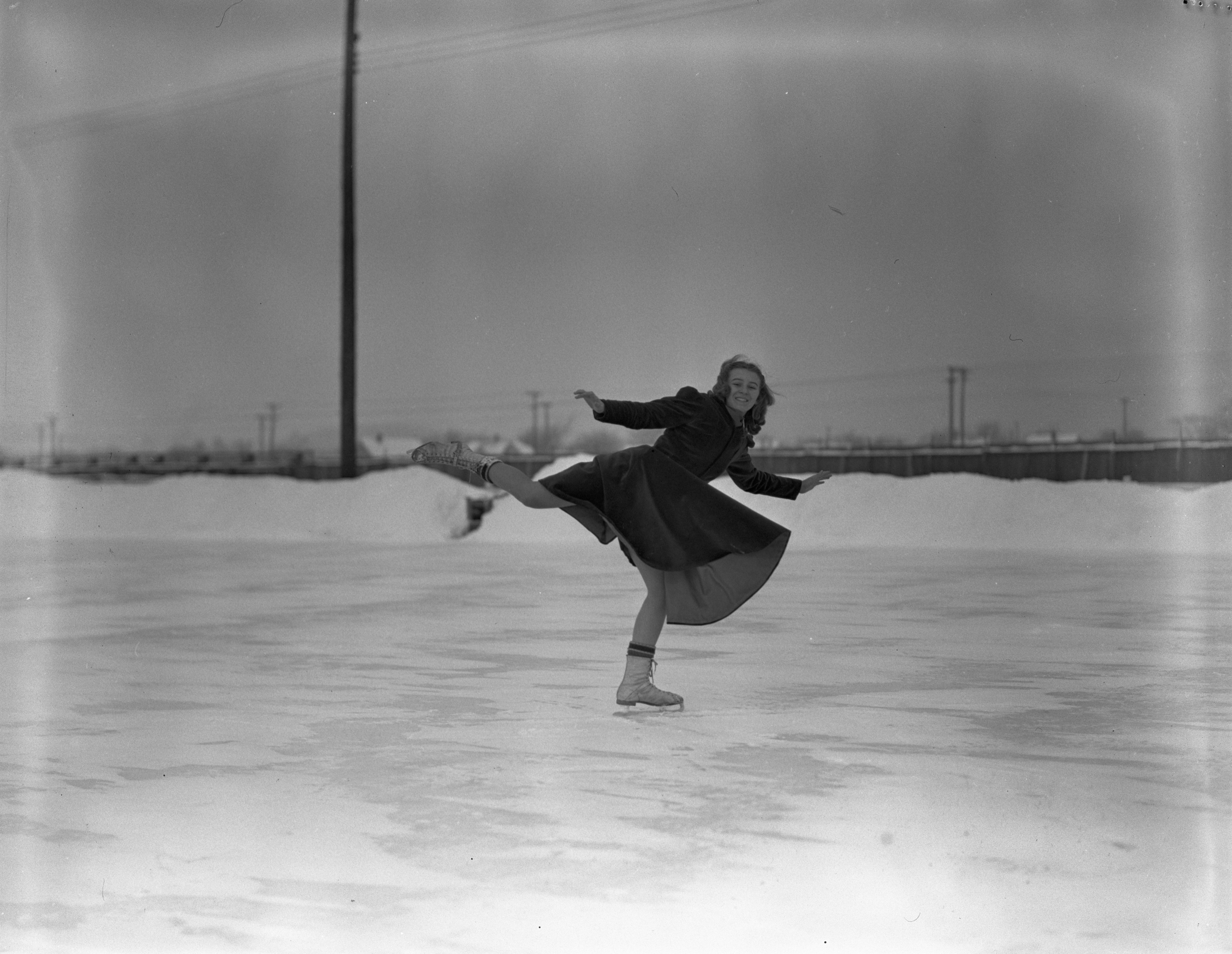 Figure Skater On Outdoor Ice Rink In Traverse City, January 1940 image