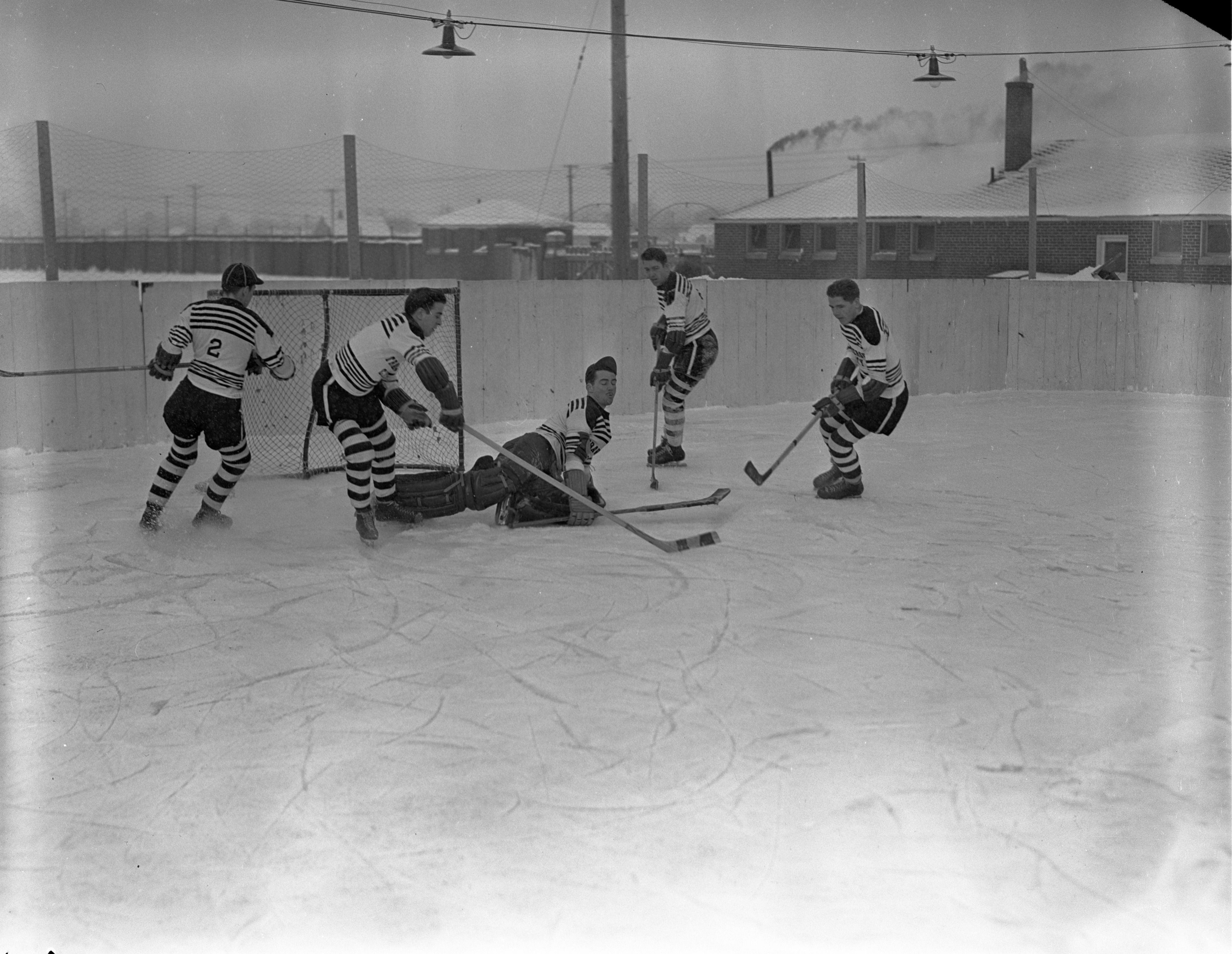Protecting The Goal While Playing Hockey In Traverse City, January 1940 image