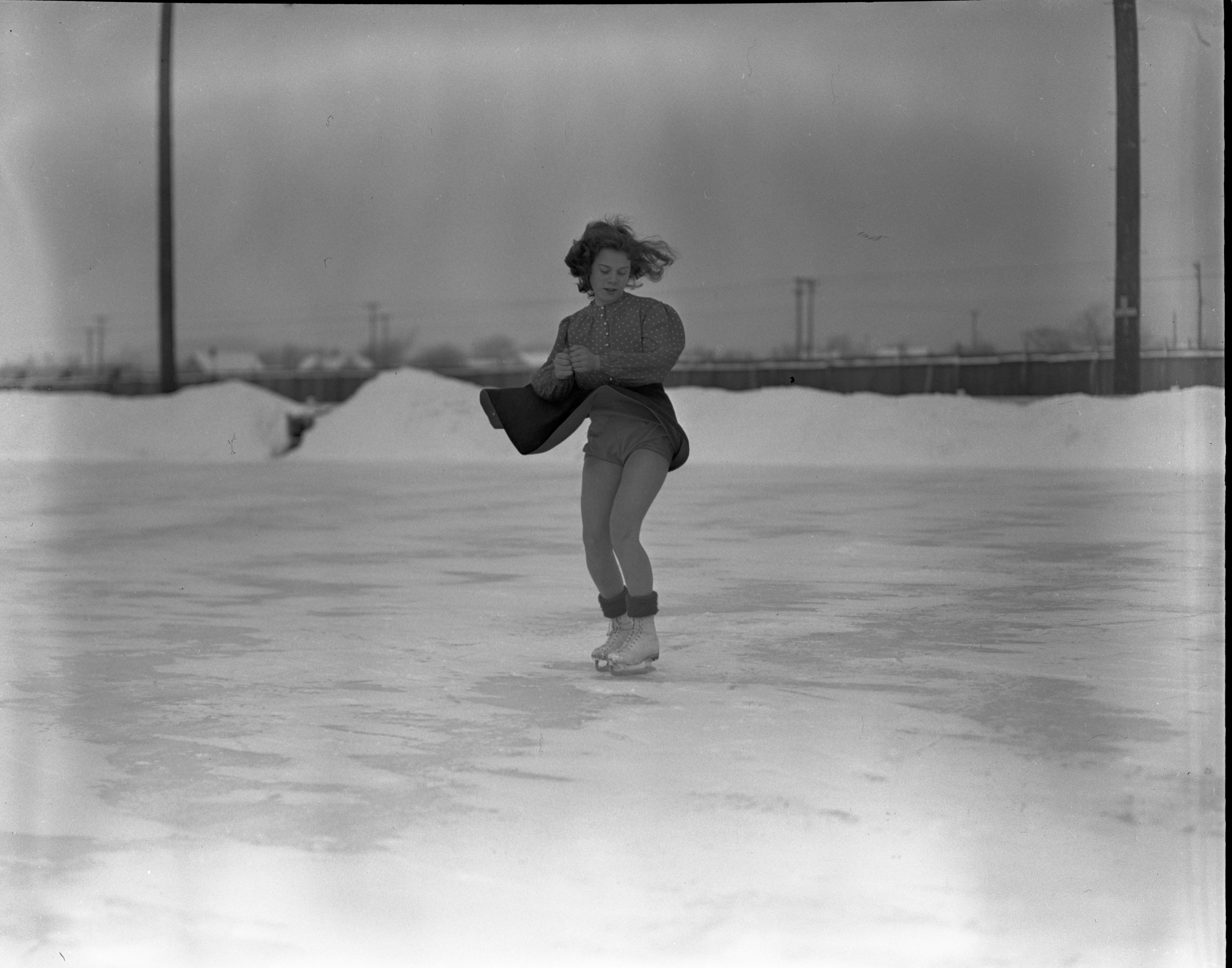 LaVarne Conant Figure Skates On Outdoor Ice Rink In Traverse City, January 1940 image