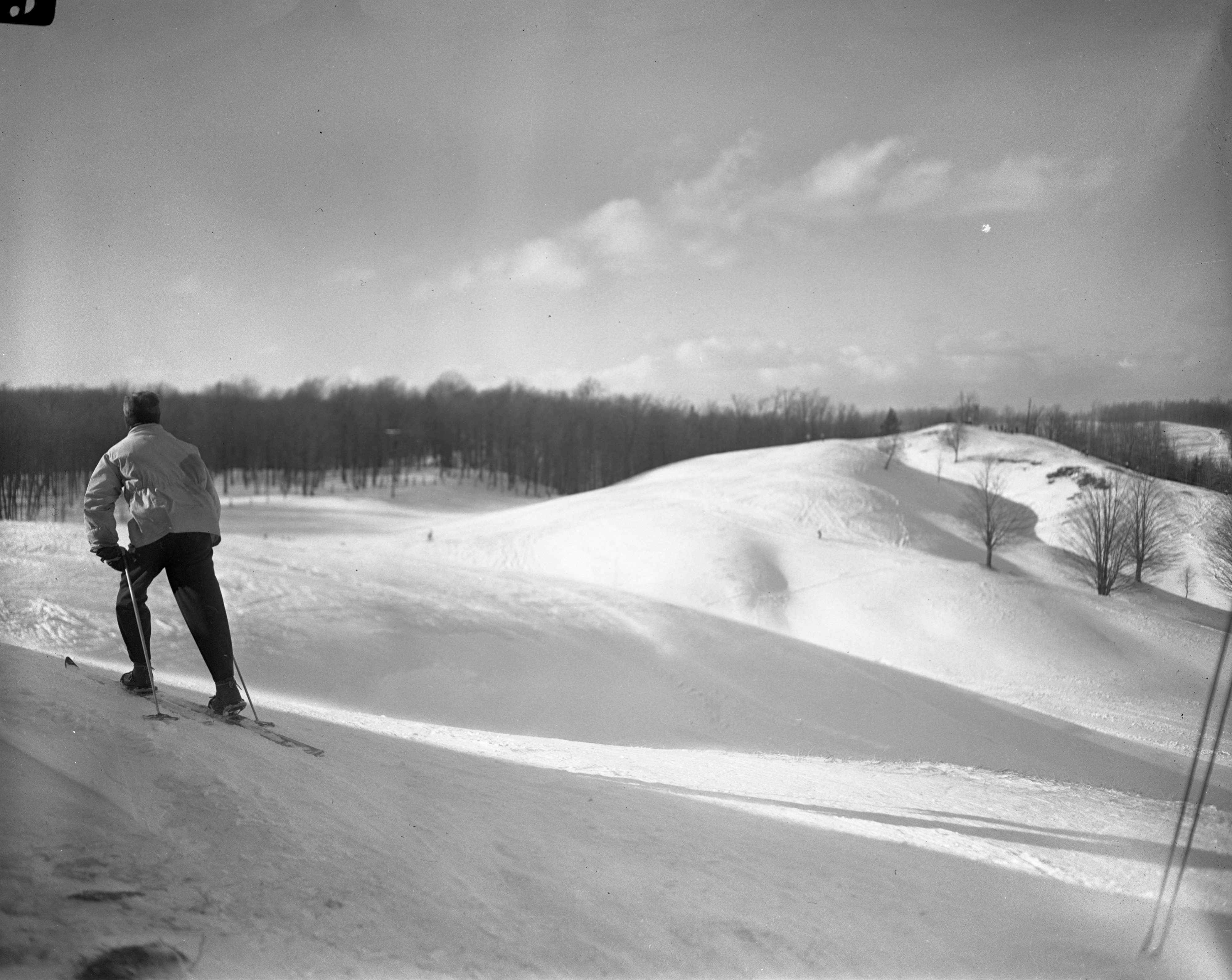 Skier Looking Out Onto The Hills At The Otsego Club, February 1946 image
