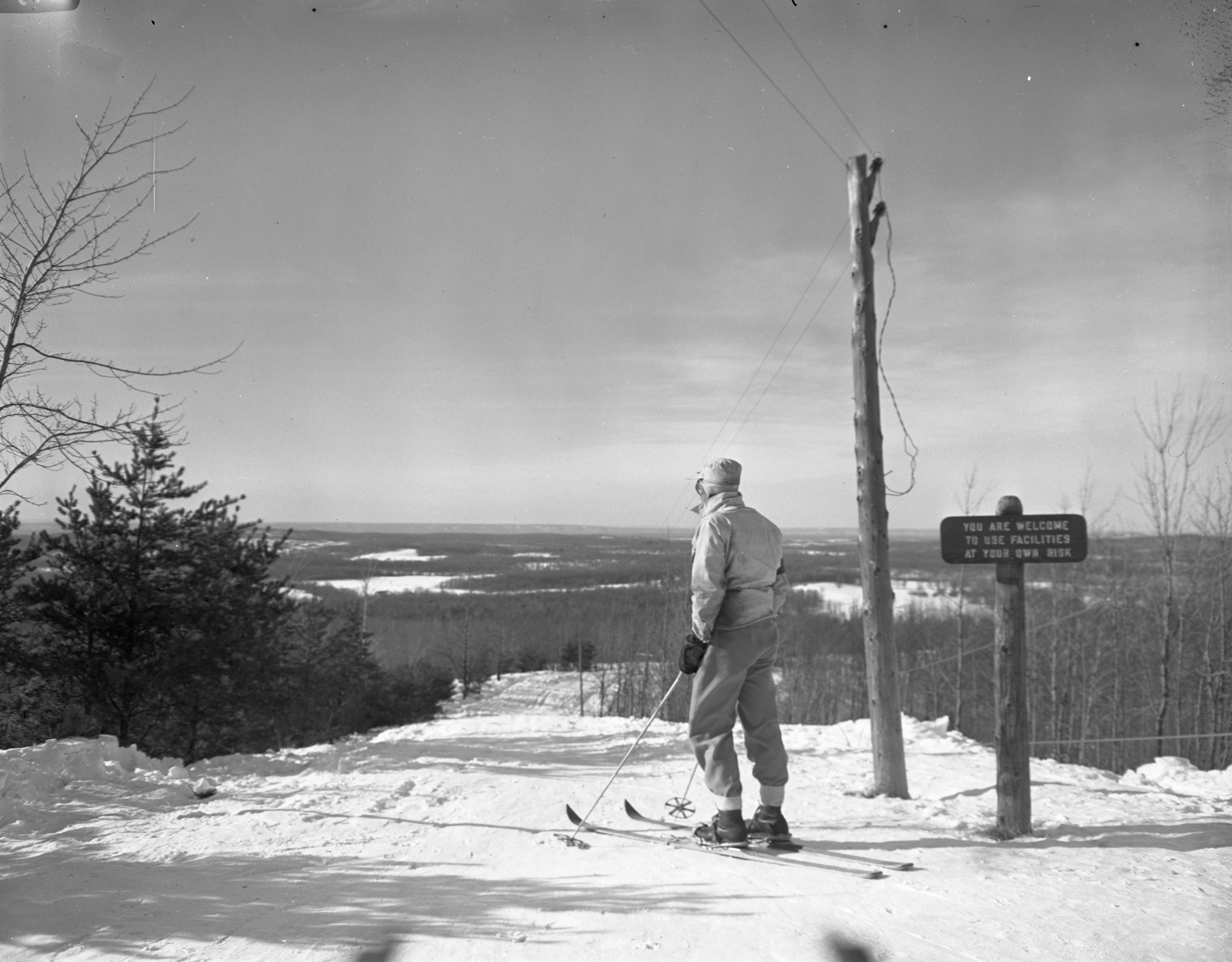 Skier Looks Down The Hill At Caberfae In Cadillac, February 1946 image