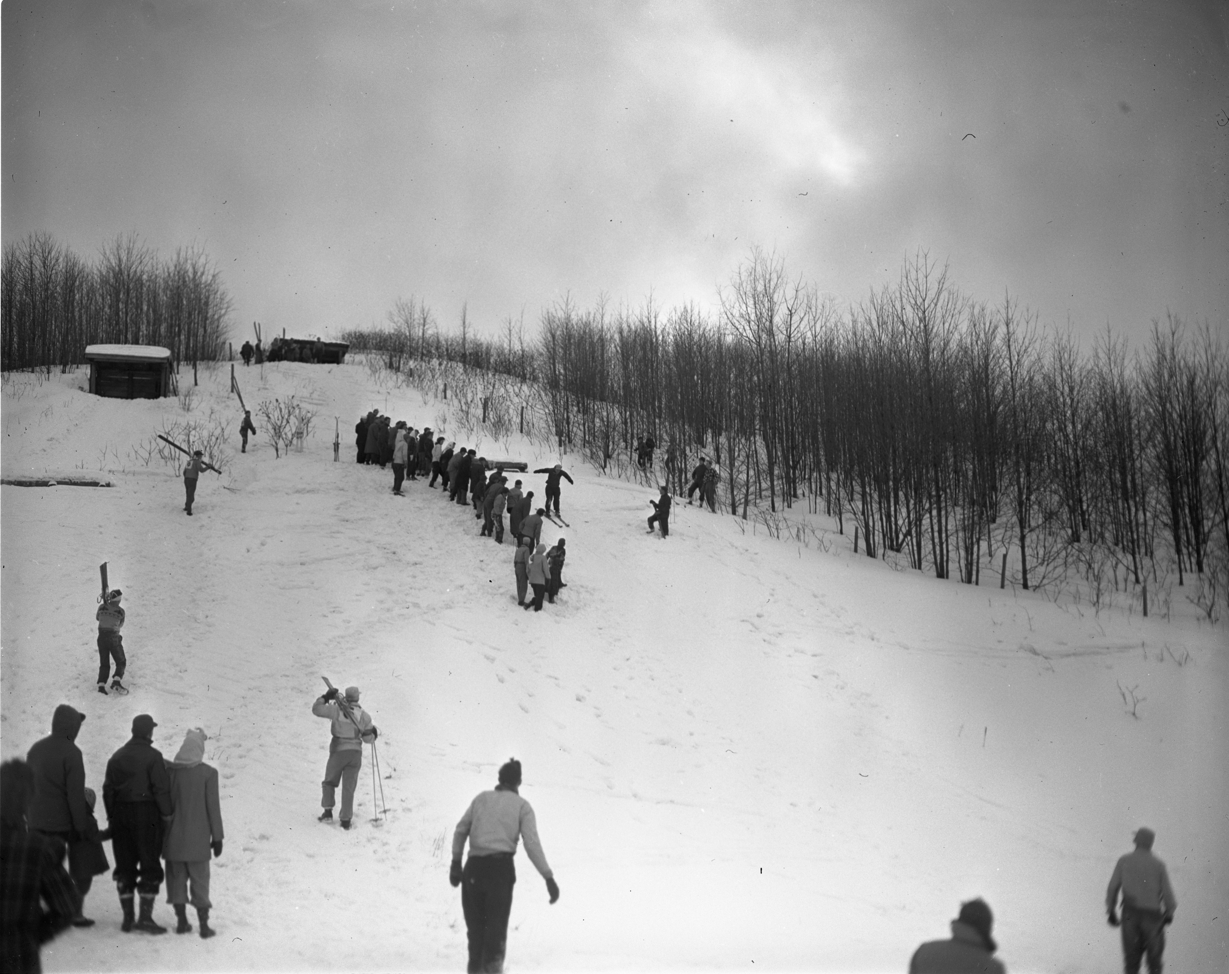 Onlookers Surround A Ski Jump At Caberfae In Cadillac, February 1946 image