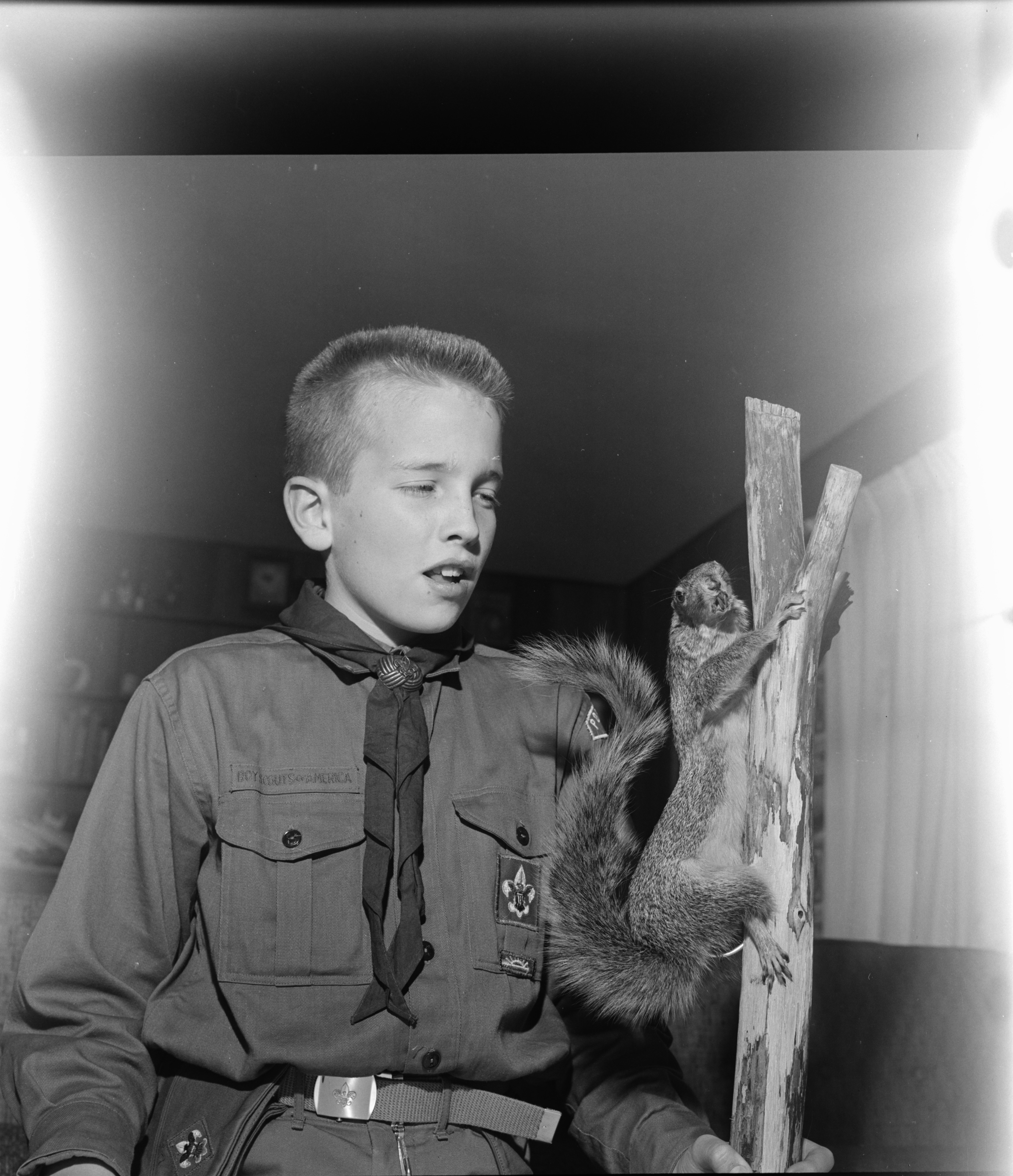 Doug Carpenter Displays Taxidermied Squirrel, February 1963 image