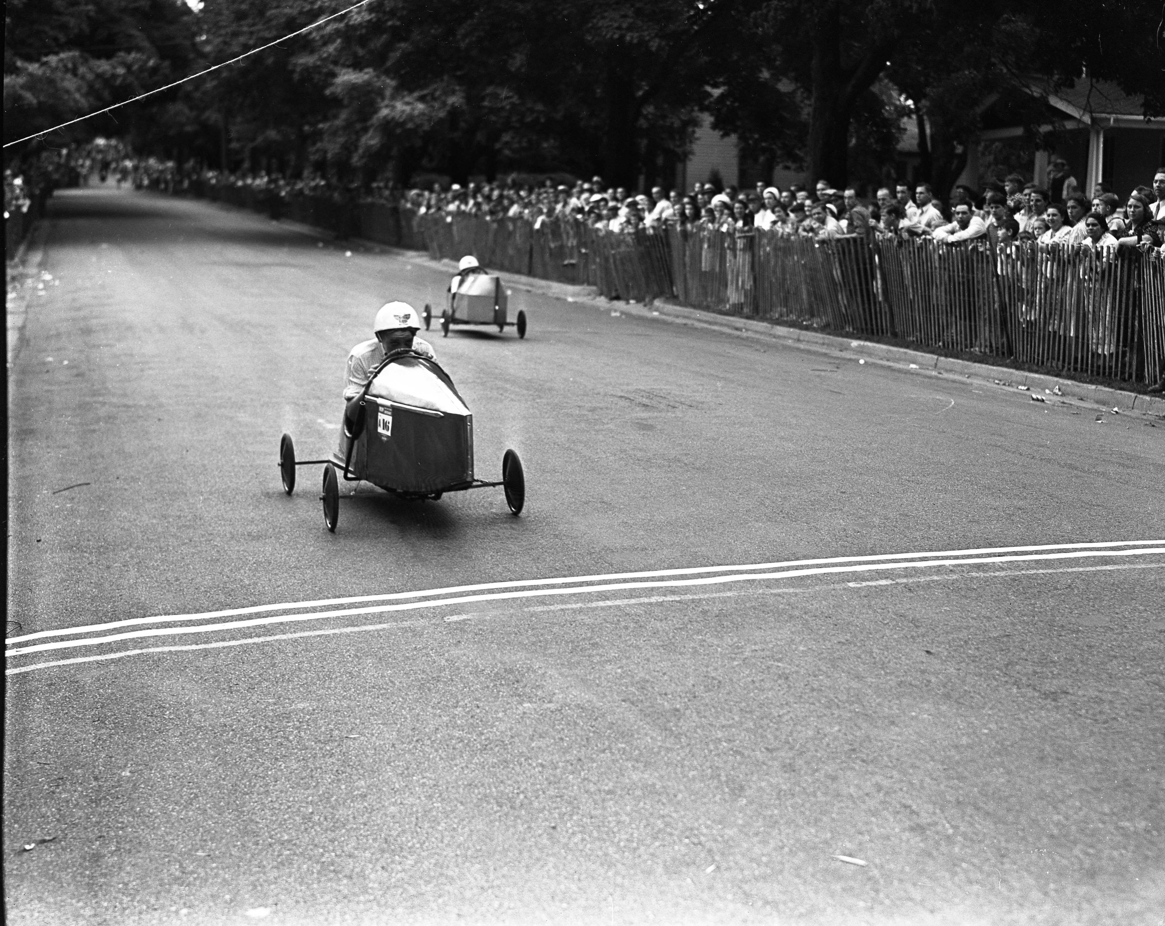 Dexter's Robert Moore wins a heat in Ann Arbor's Soap Box Derby, July 1939 image