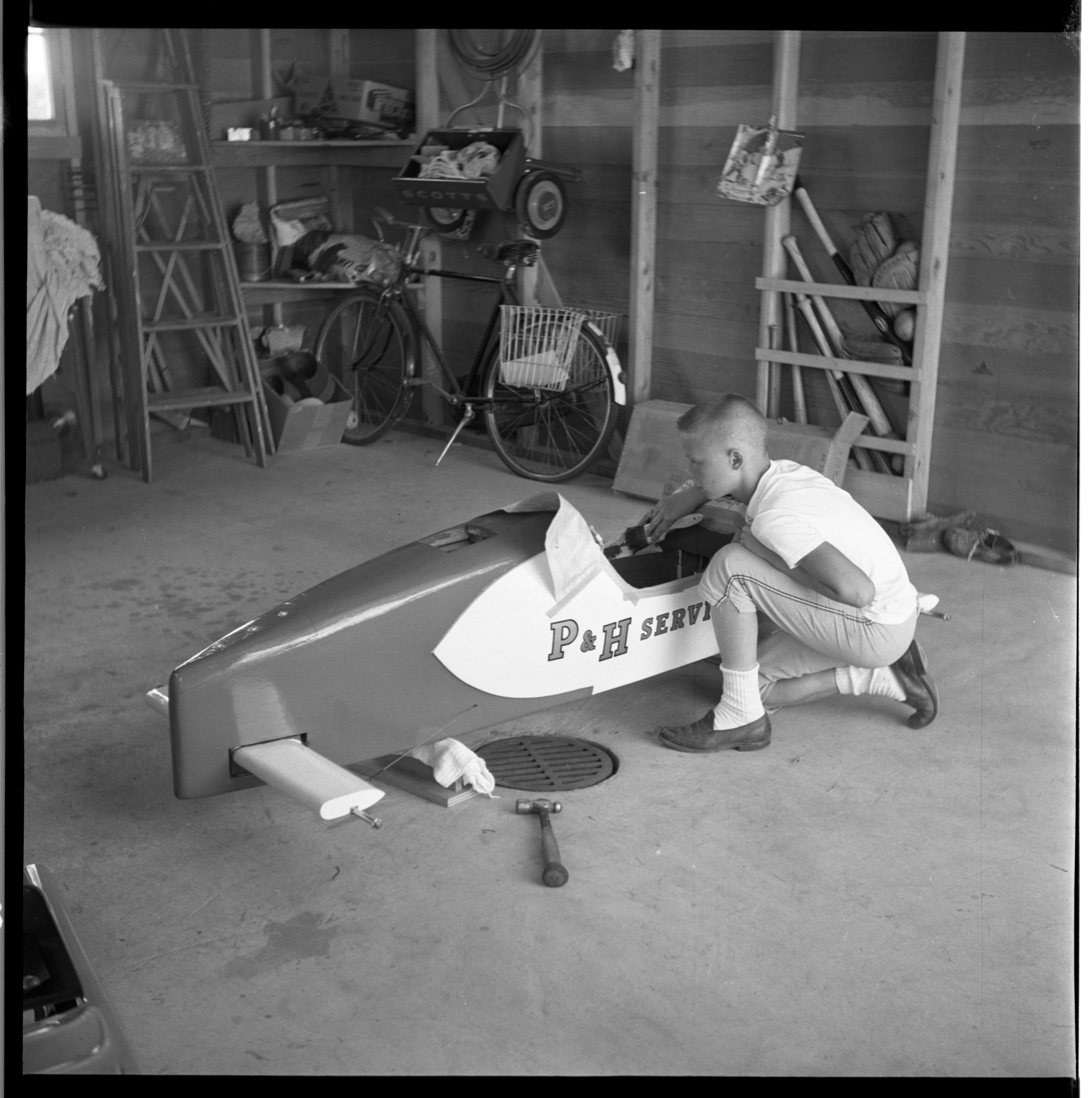 Craig Rigan Completing His Soap Box Derby Racer, July 1963 image