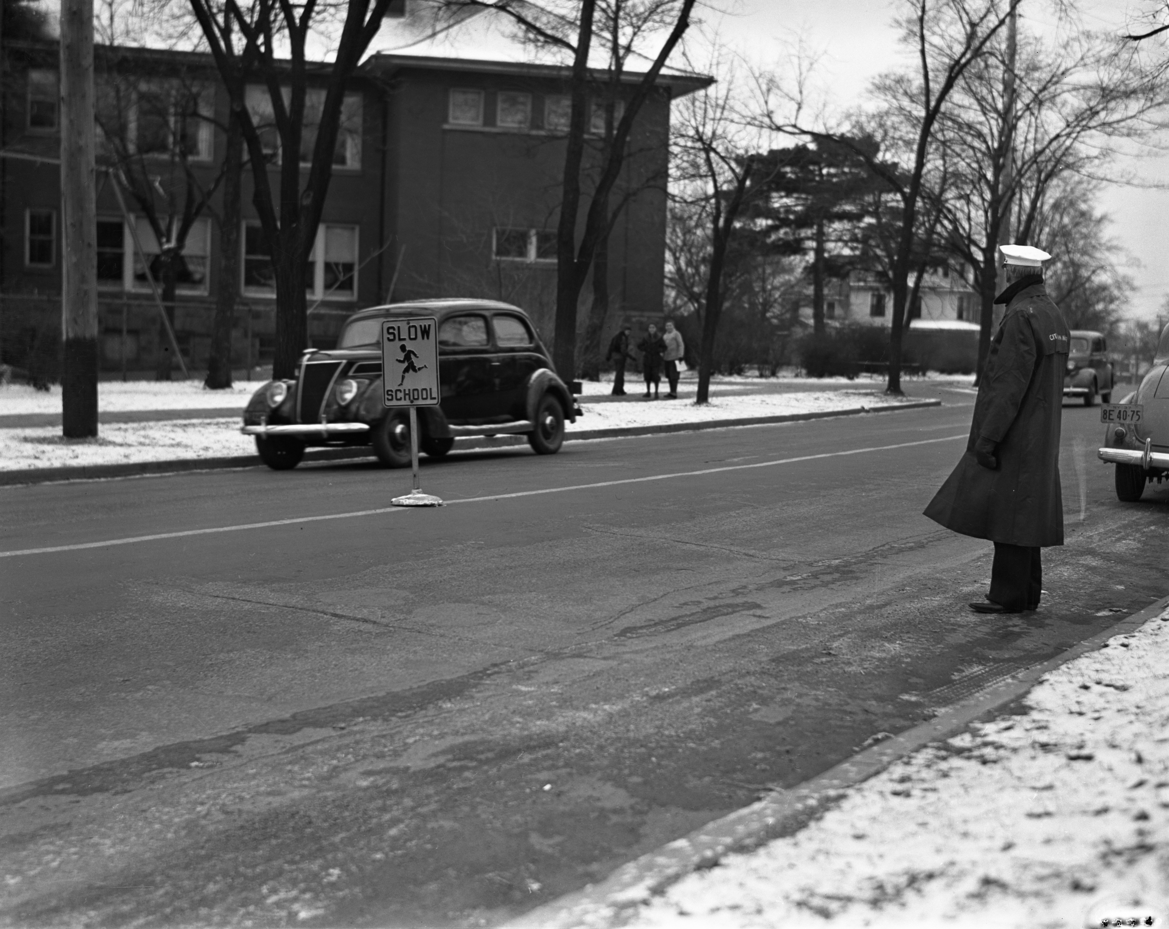 School Traffic Sign and Crossing Guard Outside Perry Elementary School, November 1937 image