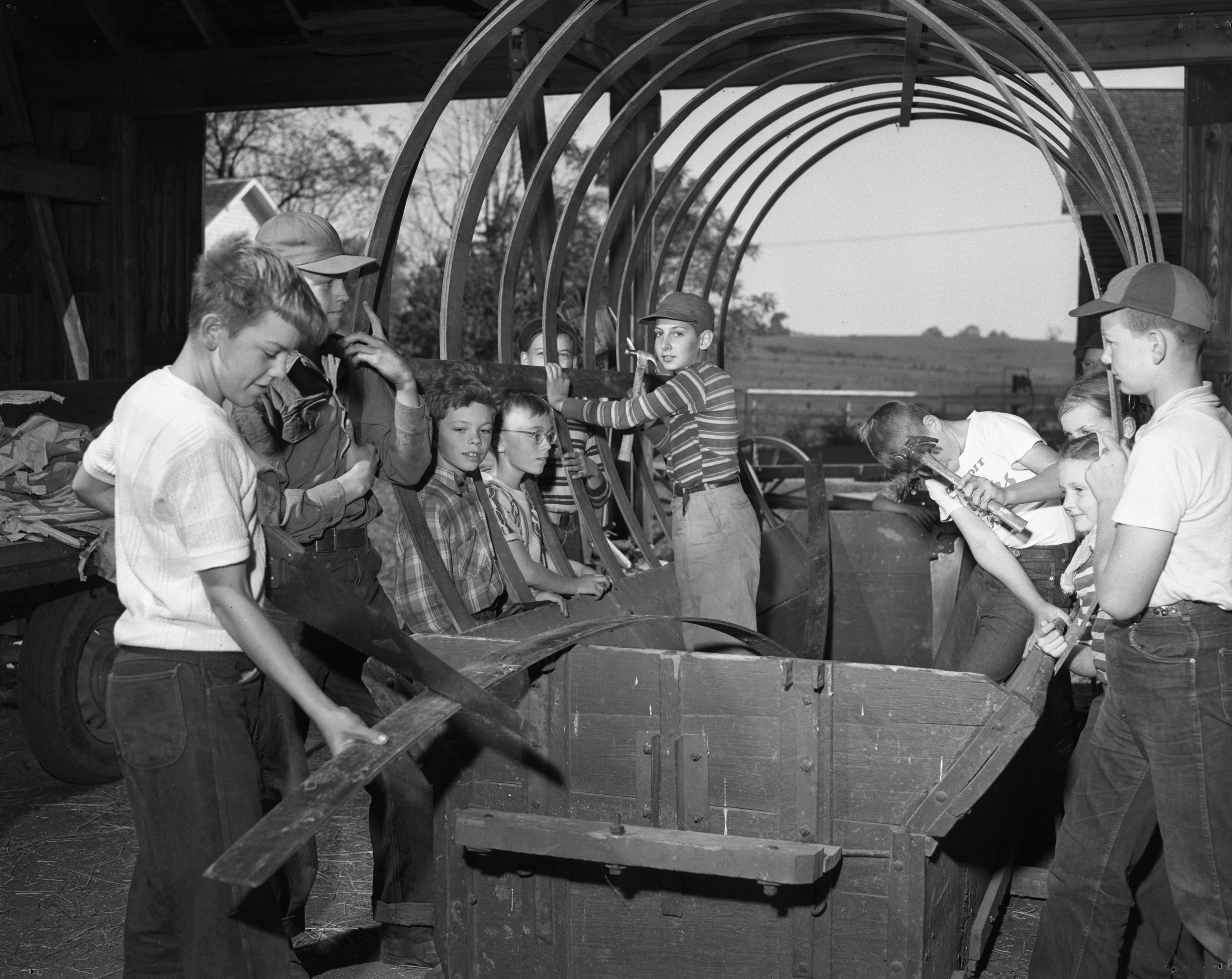Jewett Stone School kids work on prairie schooner for parade, September 1950 image