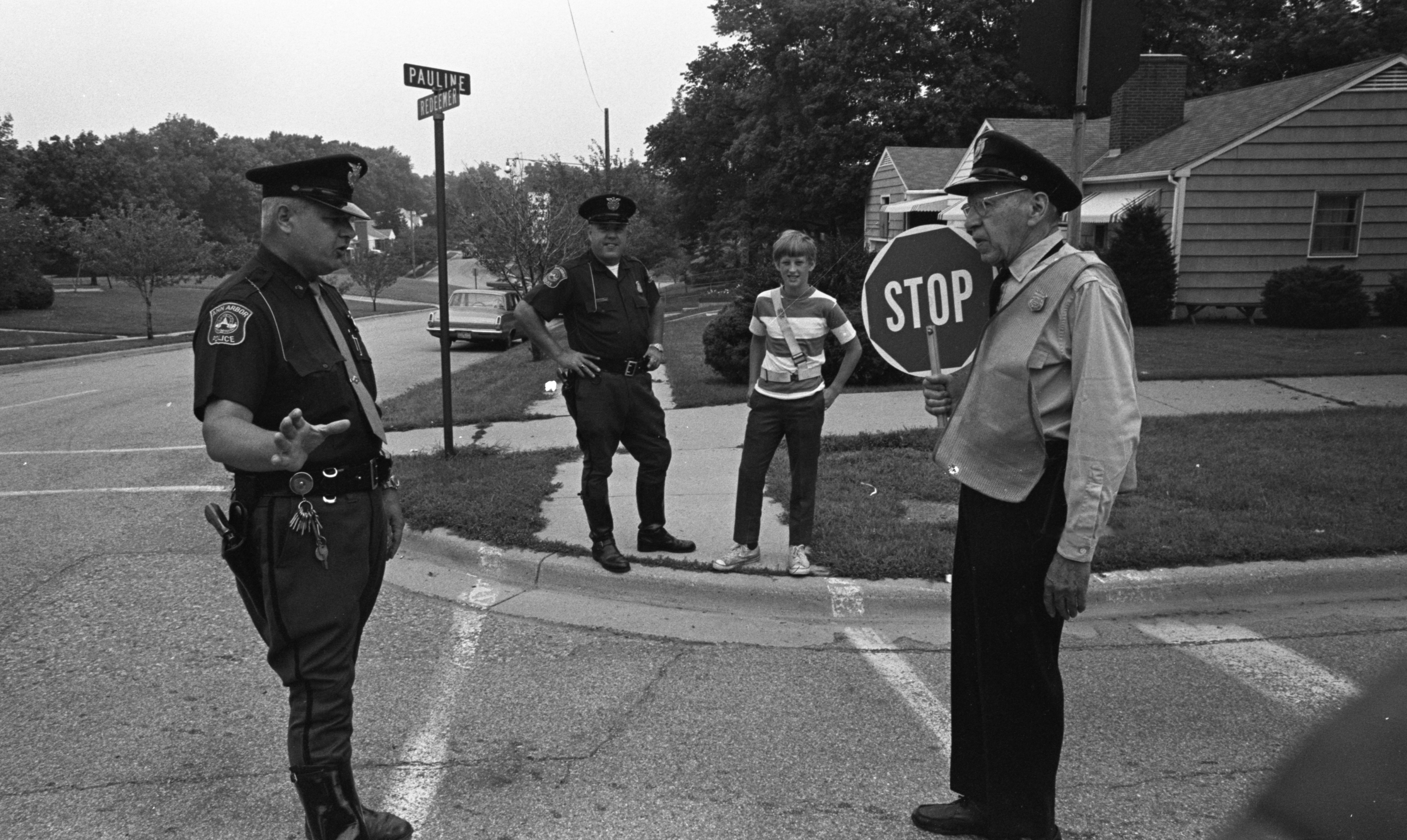 Ann Arbor Policemen Provide Back To School Tips For Crosswalk Safety At The Corner of Pauline & Redeemer, August 1970 image