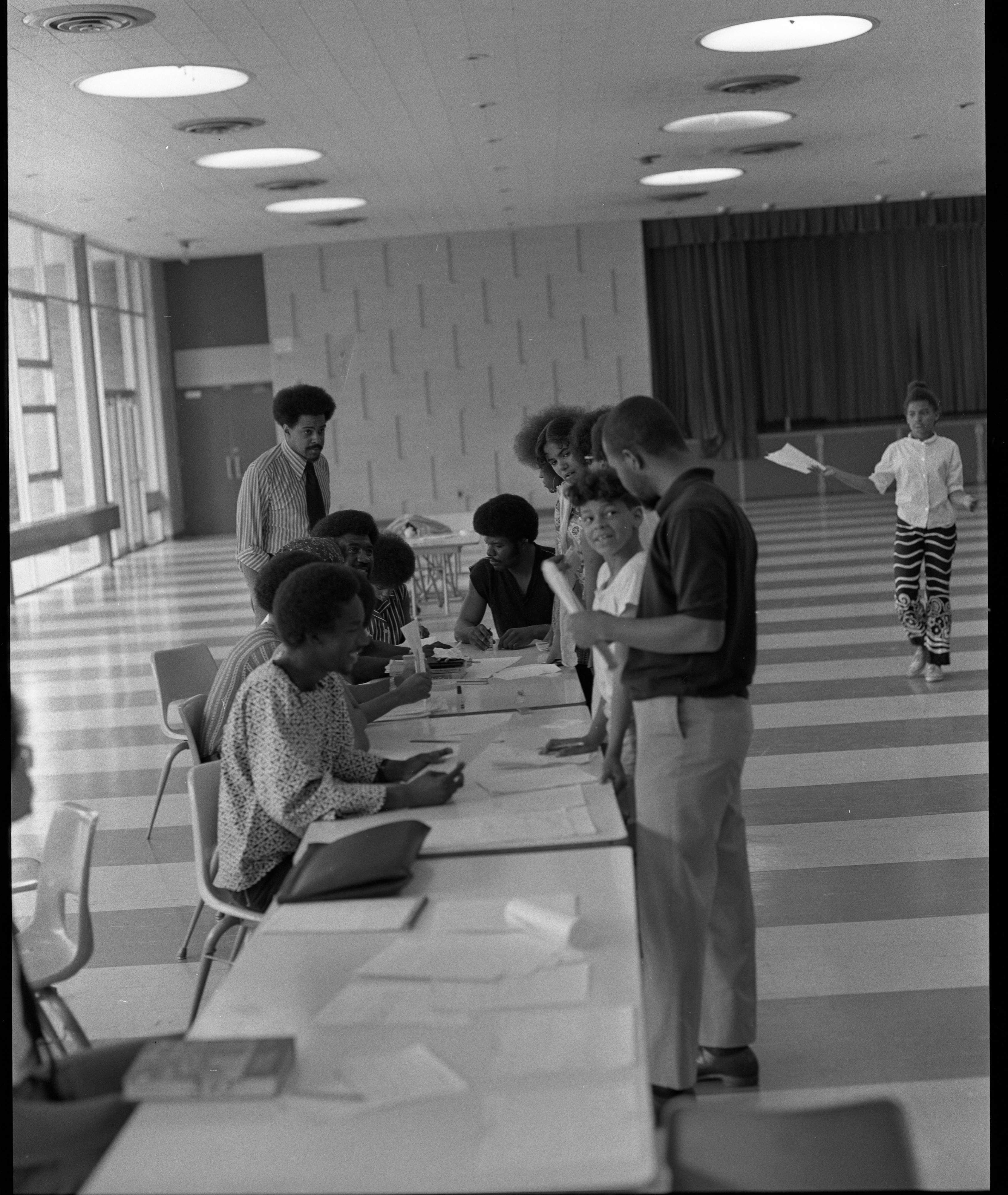 O'Dell Lewis Watches Students Enrolling In Summer School At Forsythe Junior High, June 16, 1971 image