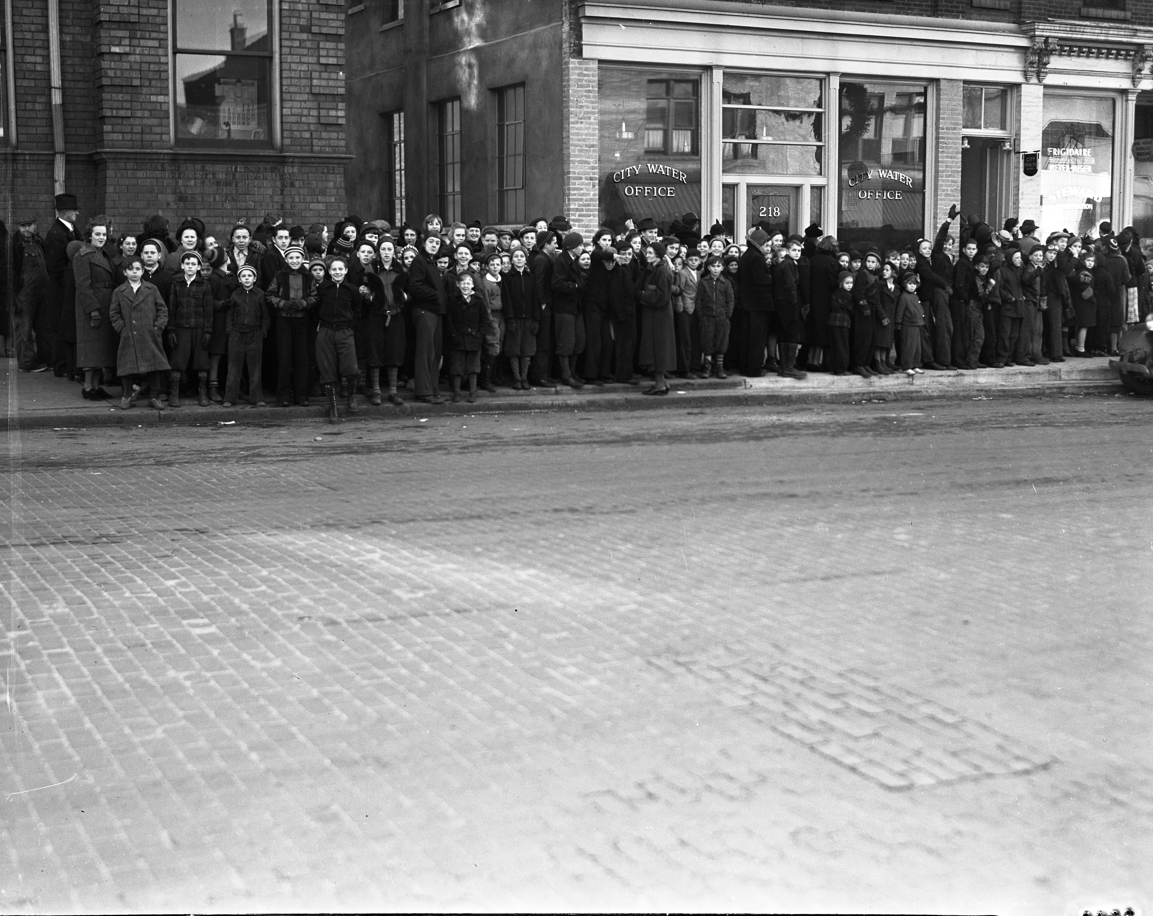 School Children Line Up On E. Huron Street For Tuberculosis Screening at Public Health Office, December 1937 image