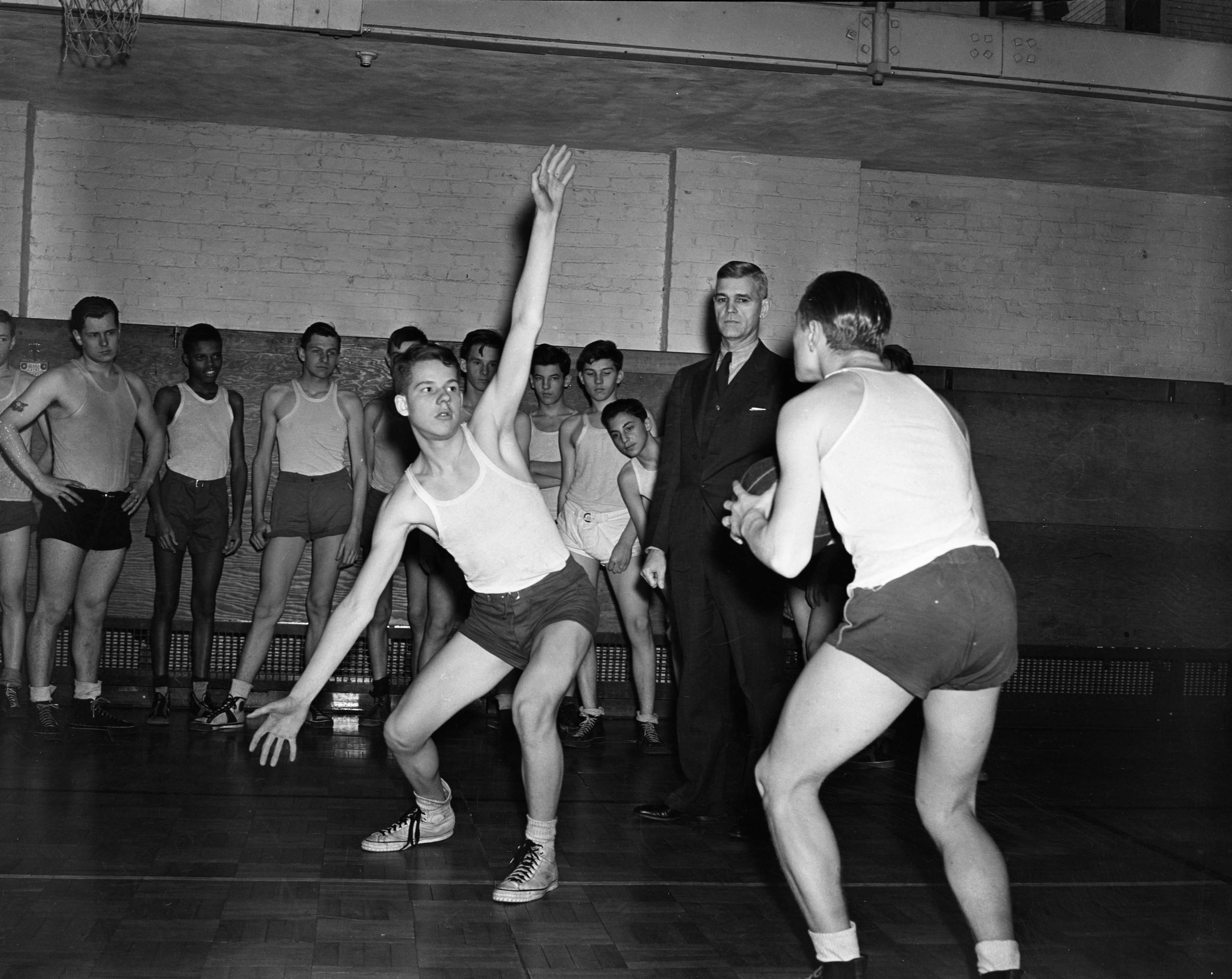 Louis H. Hollway with gym class, January 1939 image