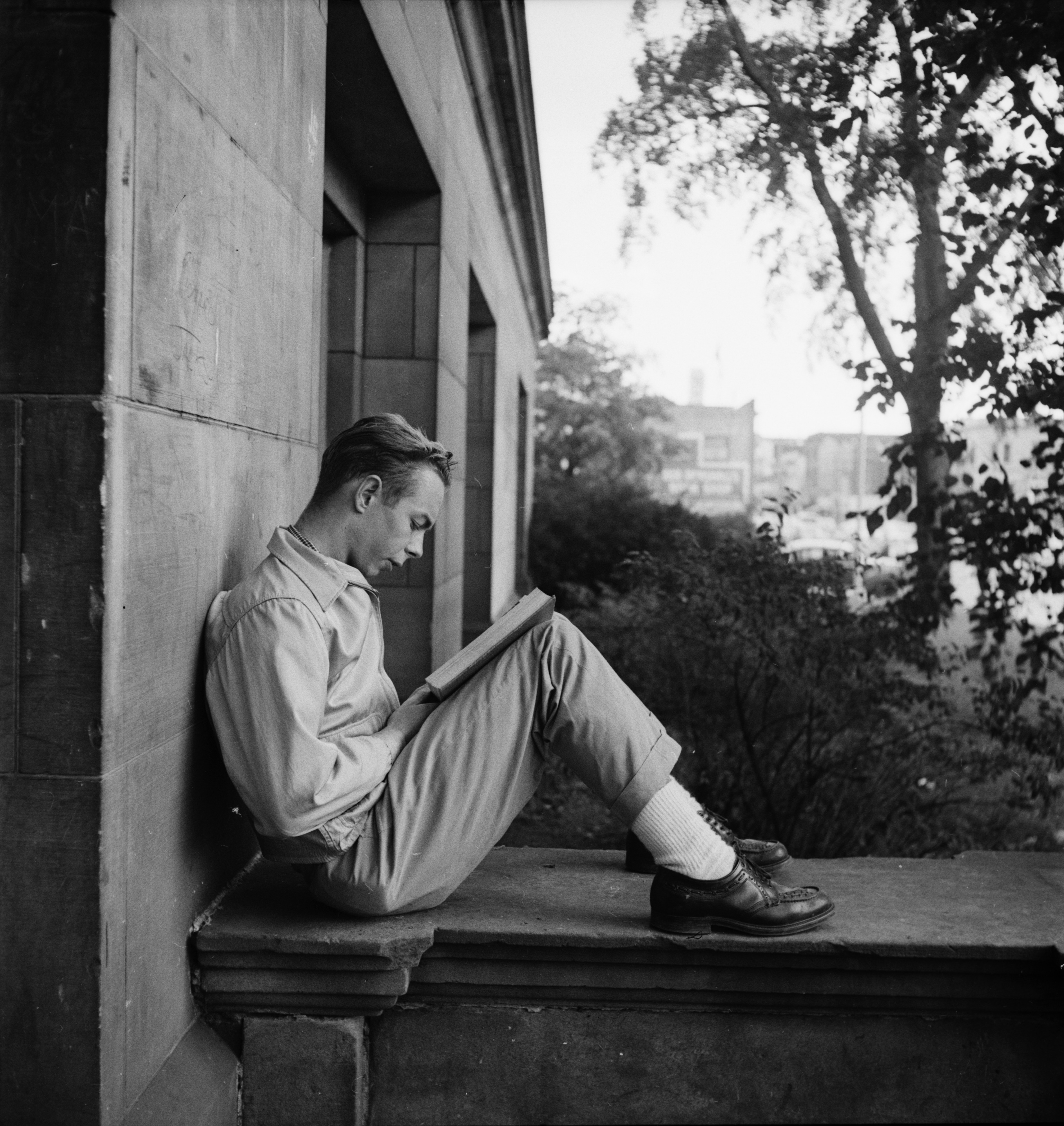 A Student Studies on the Steps of Ann Arbor High School, September 1952 image