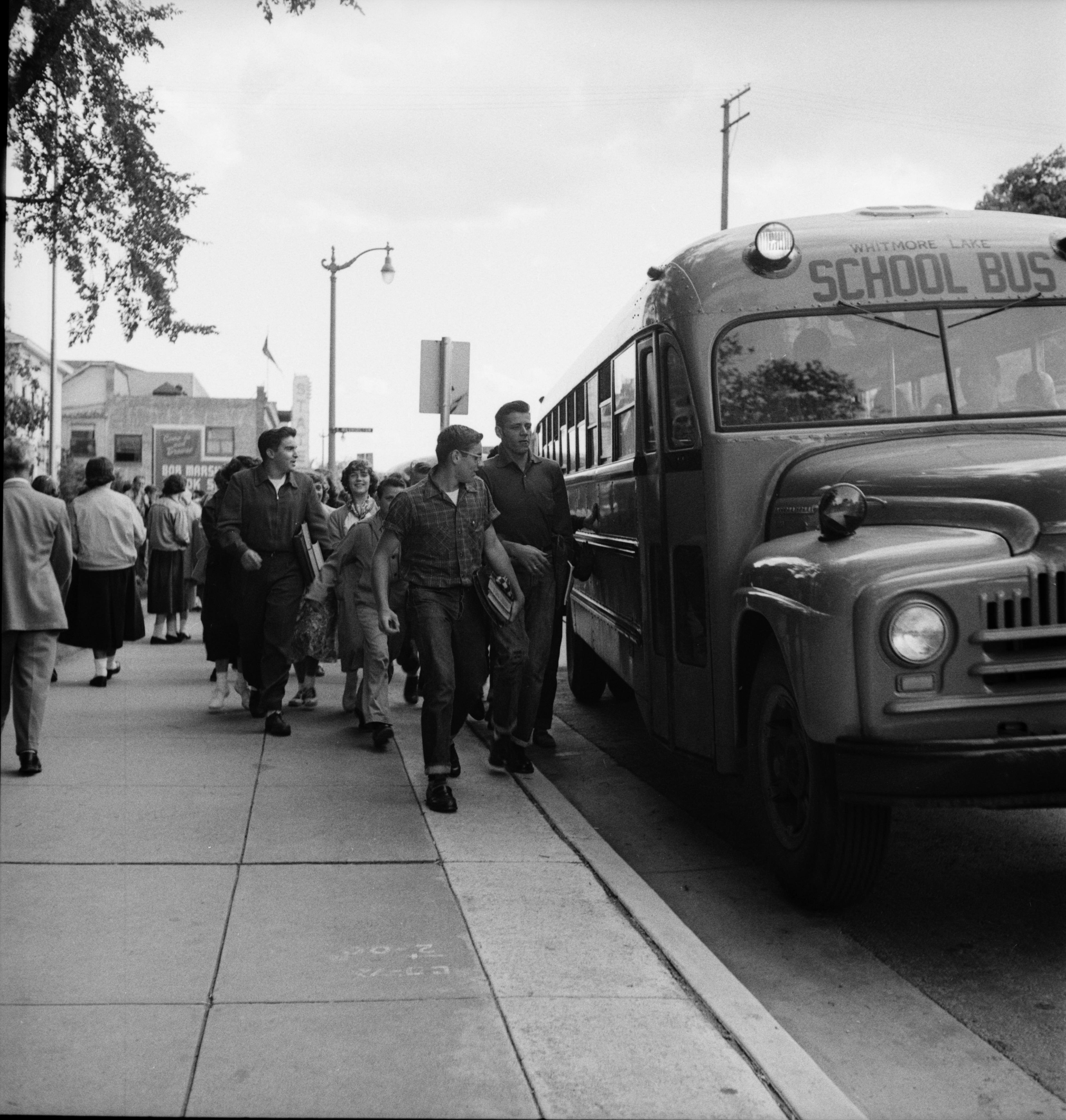 Catching A Bus In Front of Ann Arbor High School, September 1952 image
