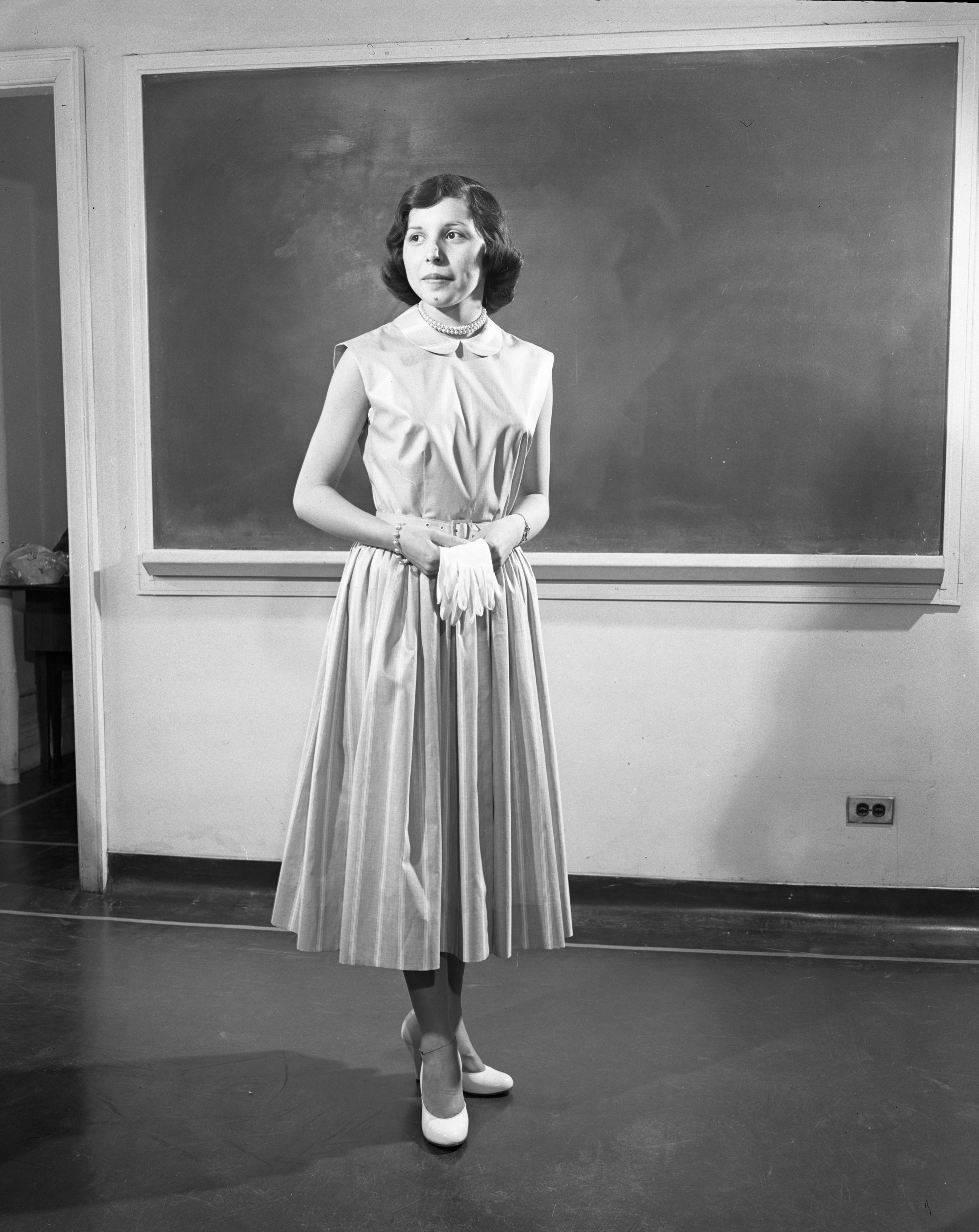 Ann Arbor High School sewing class student Shirley Driver models an outfit made for a style show, April 1953 image