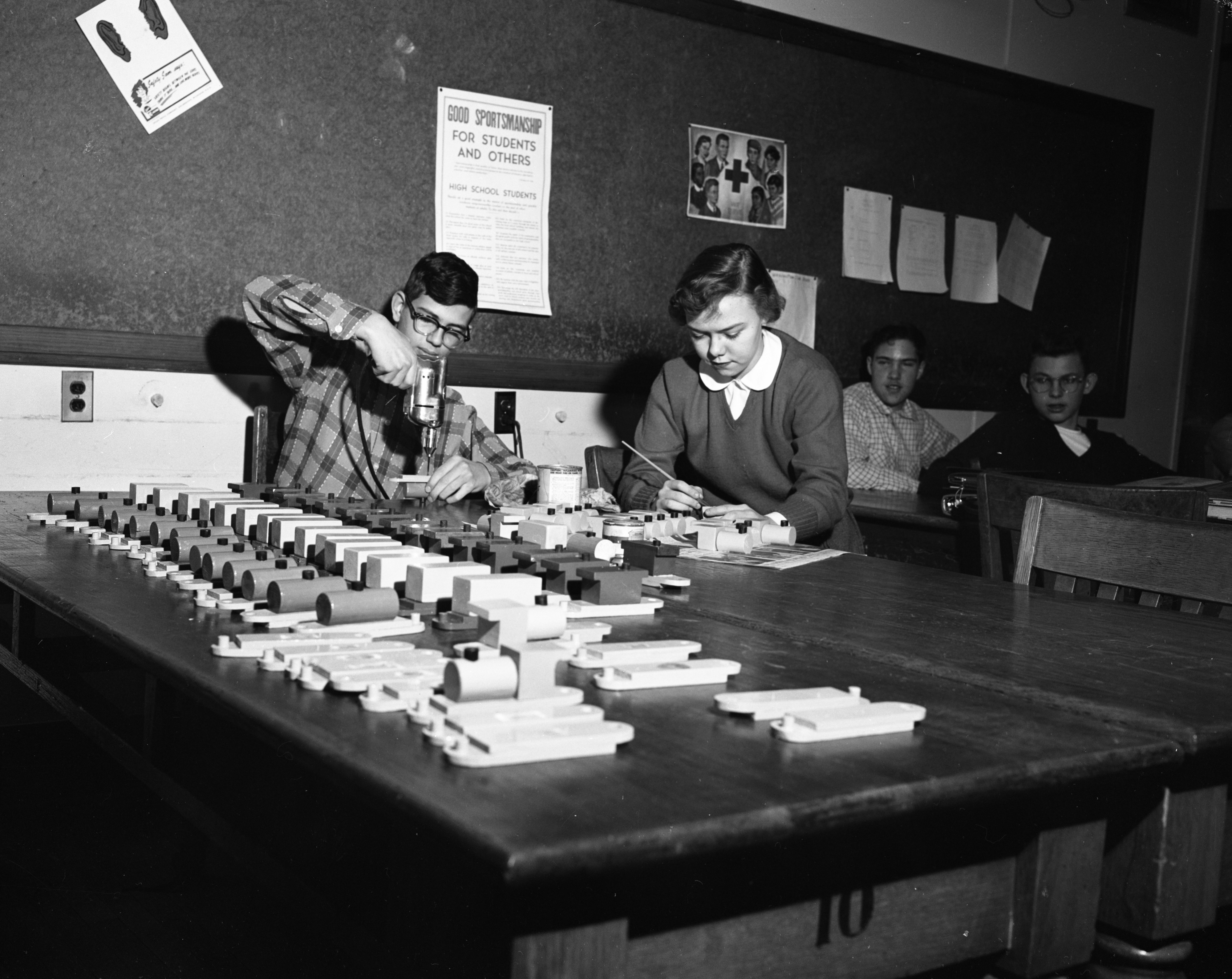 Ann Arbor High School students Dave Sattinger and Mary Kapp make toys for Salvation Army, December 1955 image