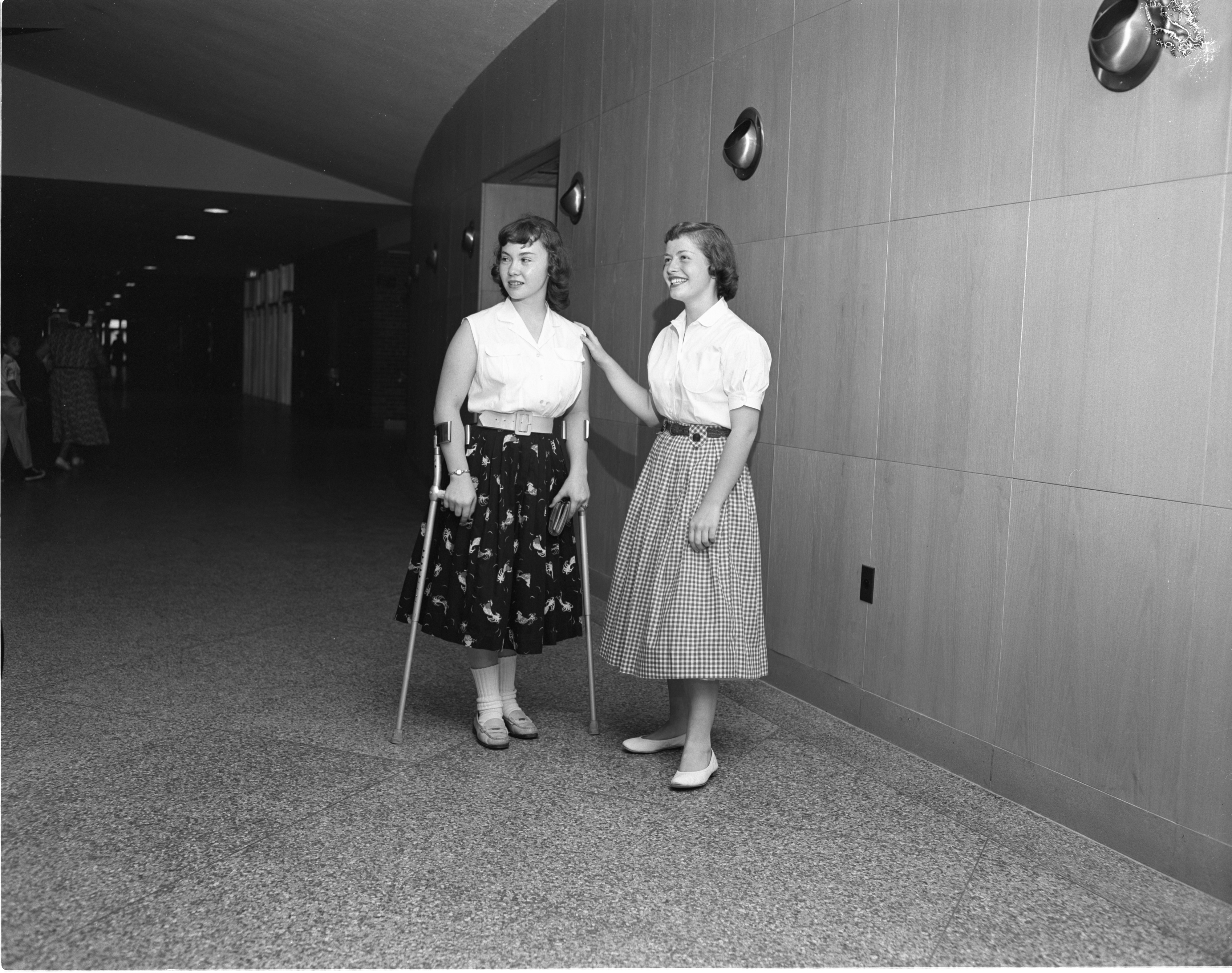 "Pat Kuohn Gets A Tour Of Ann Arbor High School From Her ""Big Sister"" Judy Fingerle, August 1956 image"