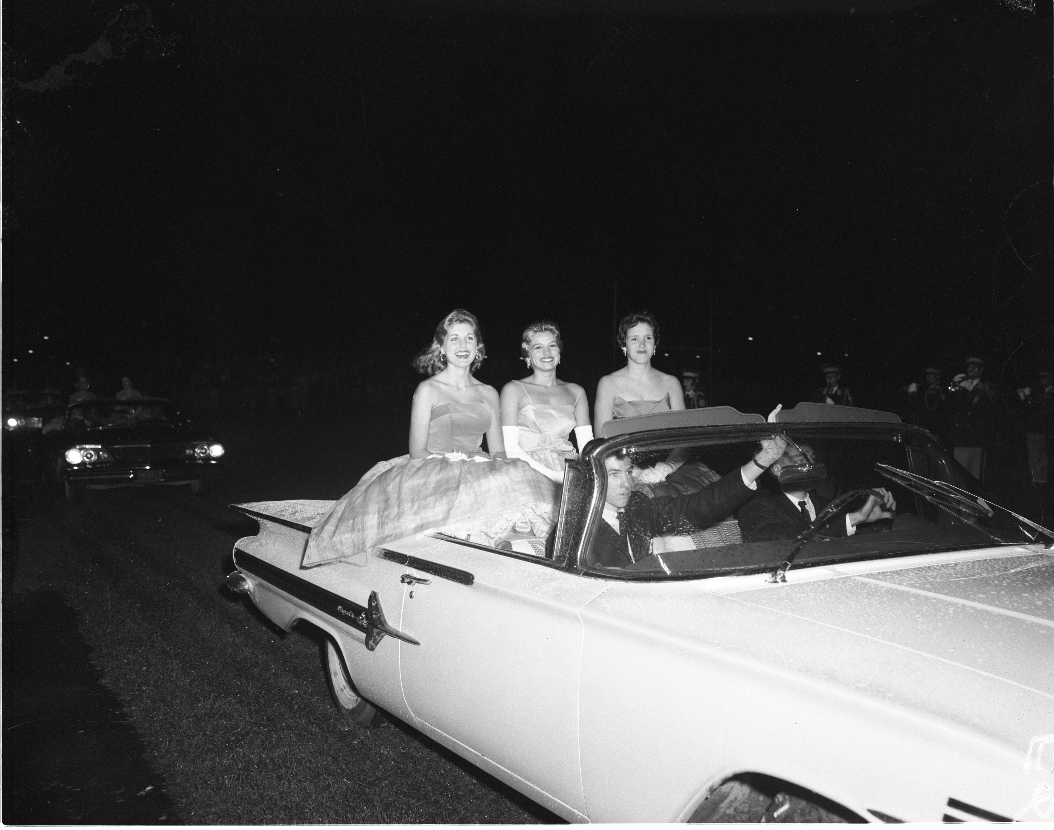 Mary Palmer, Ann Arbor High School's Homecoming Queen, Rides With Senior Court Members Peg Twining & Carol Porter, October 1959 image