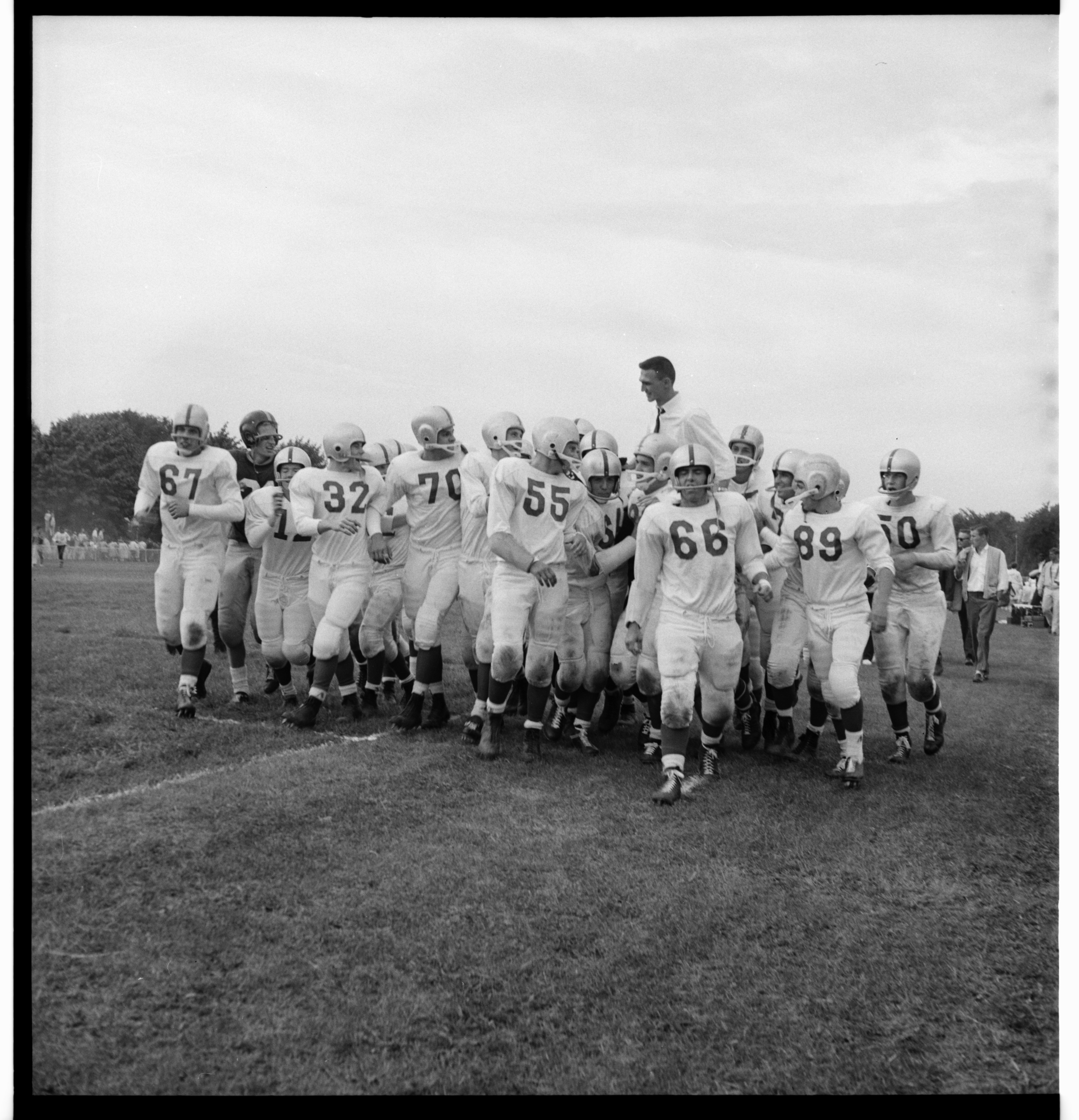 Coach Jay Stielstra is Hoisted By His Team at the Ann Arbor High vs. Grosse Pointe Football Game, September 1959 image