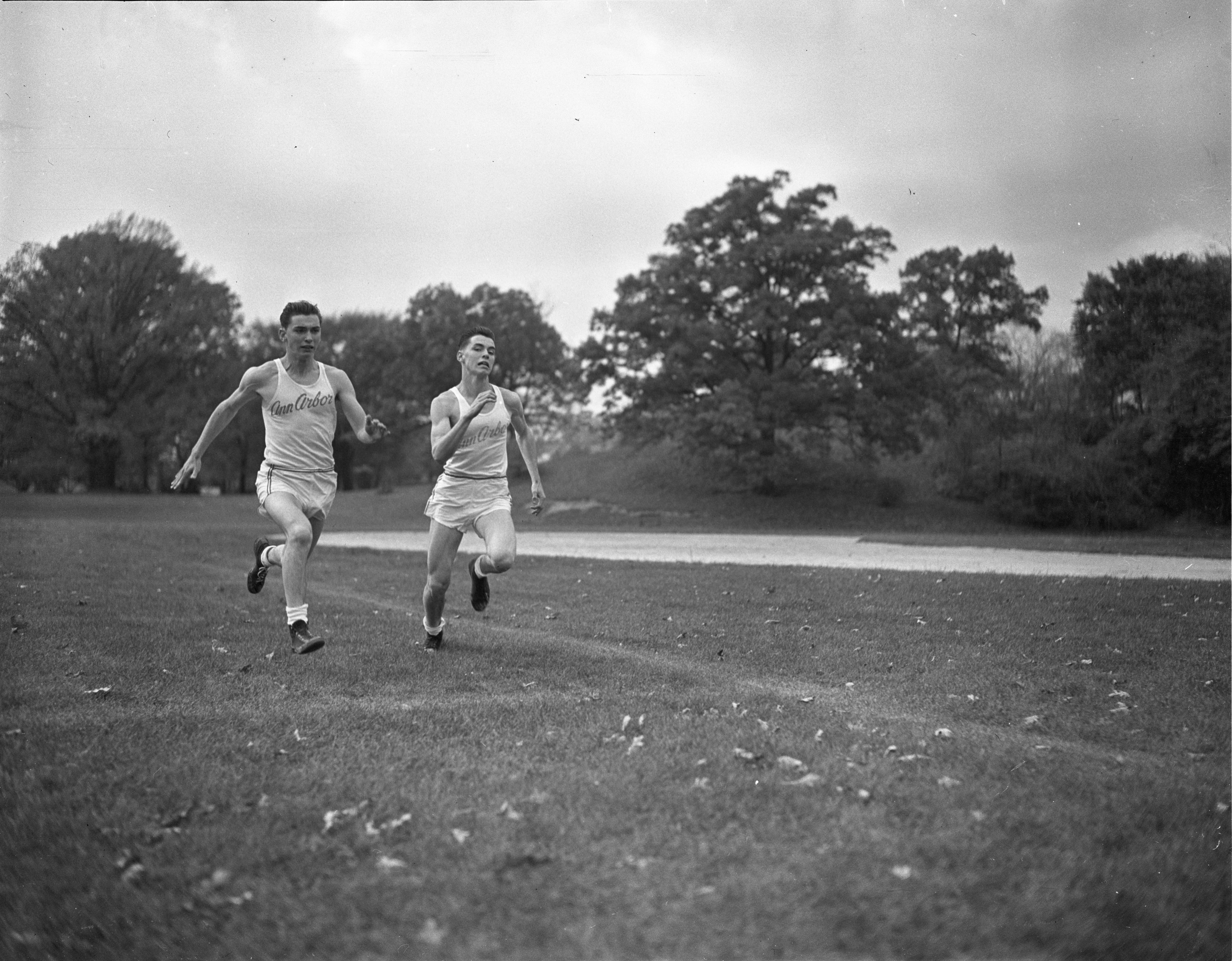 Ann Arbor High School Twins, Douglas & Donald Schleede, Compete In Five-A League Track Meet, October 1946 image