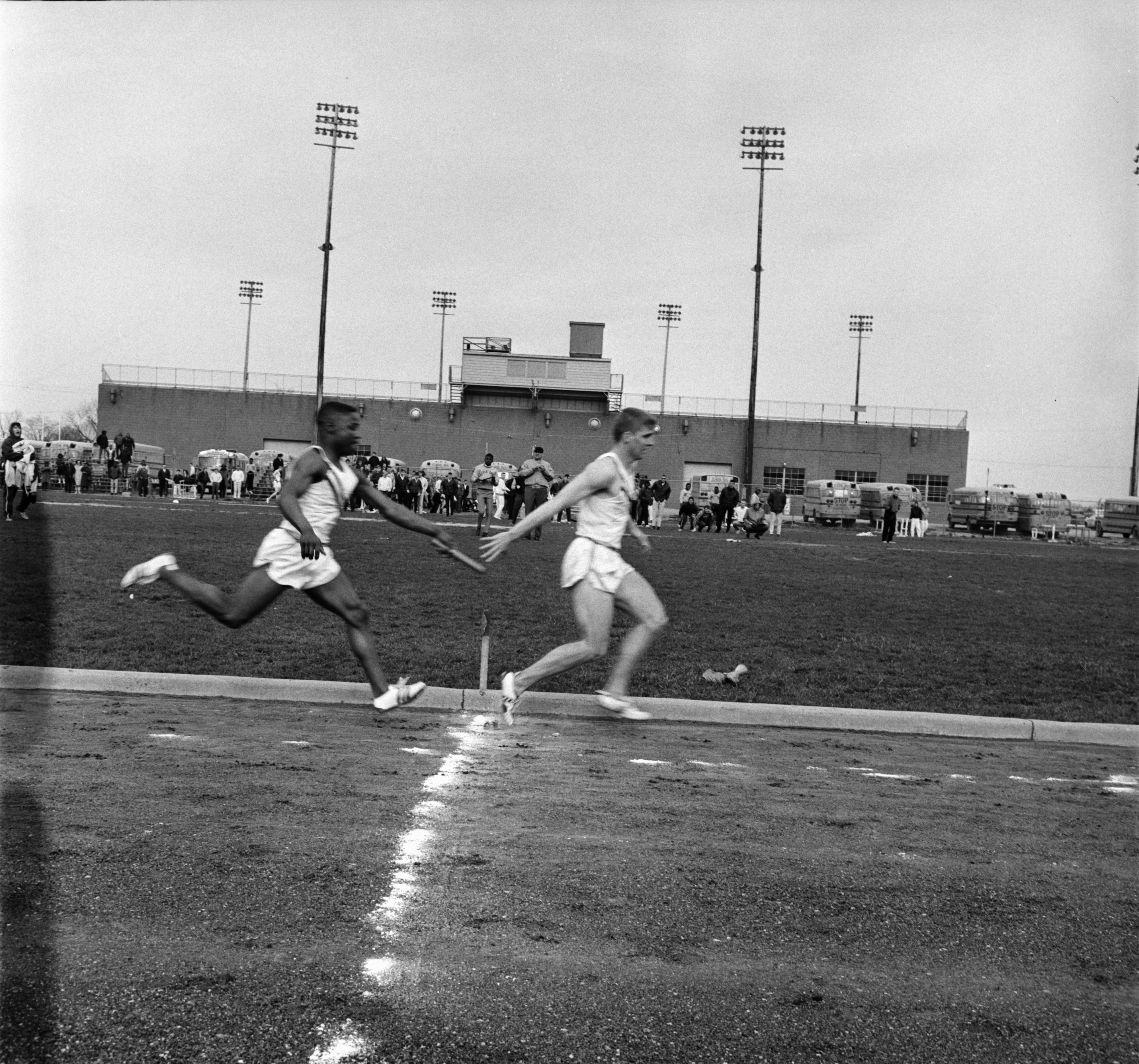 Mike Sims and Ed Oxley Run Relay for Ann Arbor High School, April 1966 image