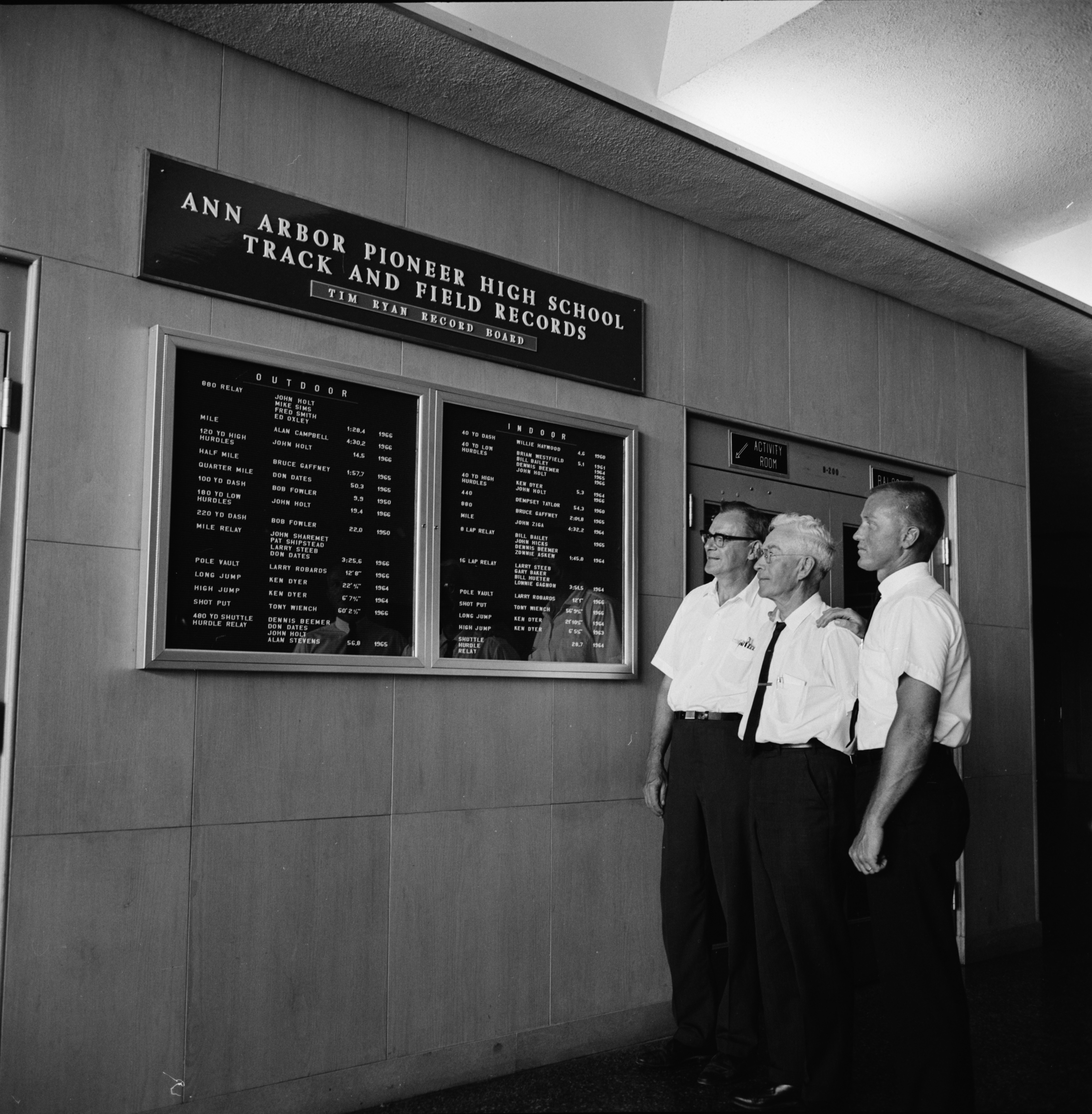 Ann Arbor High Dedicates Record Board to Former Track and Field Coach Tim Ryan, July 1966 image