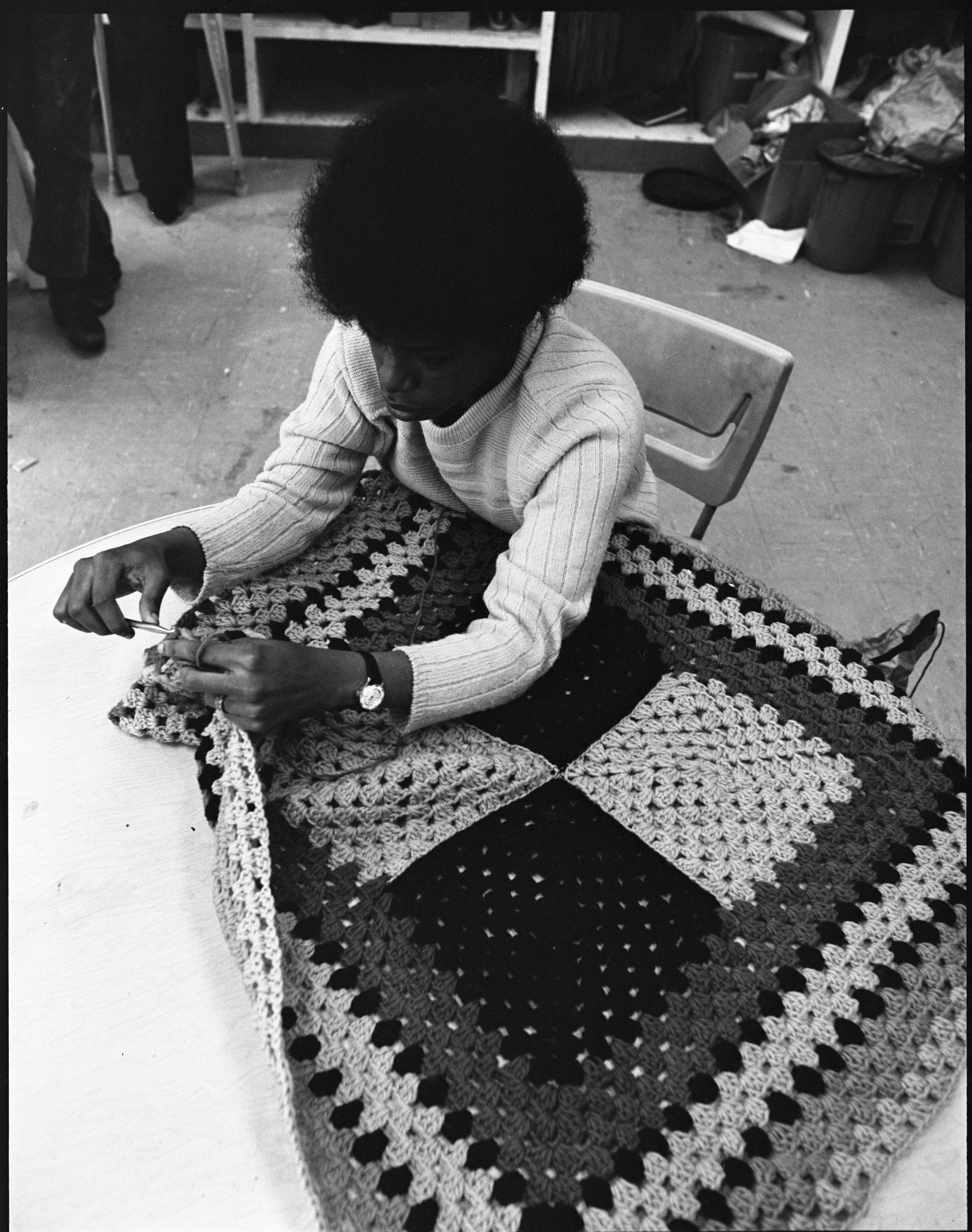 Marie Kelly Works On An Afghan In Community High School's Practical Art Program, April 1973 image
