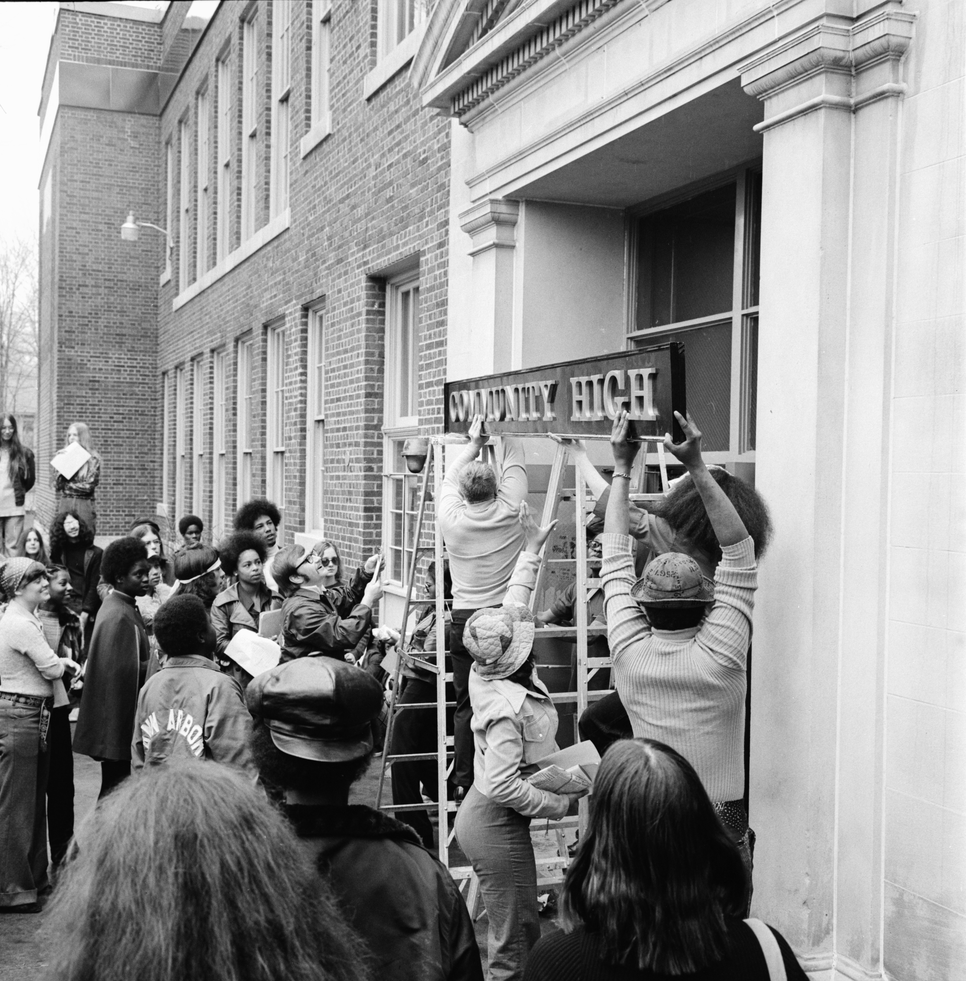 Putting up the 'Community High' nameplate at 401 N. Division, April 1974 image