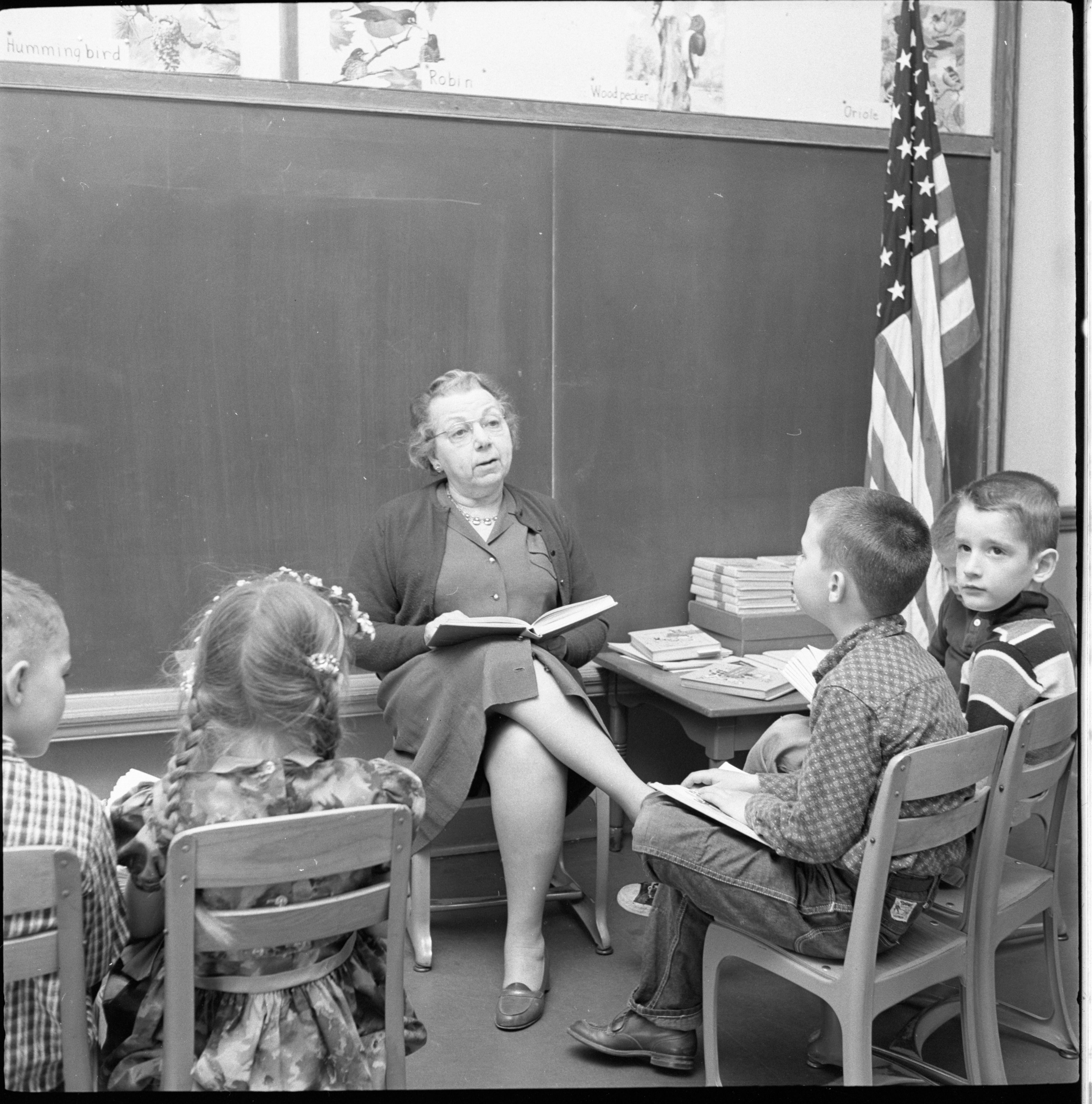 Lillian McClure Reads A Story With First Grade Students In Her Class At Burns Park School, April 1959 image