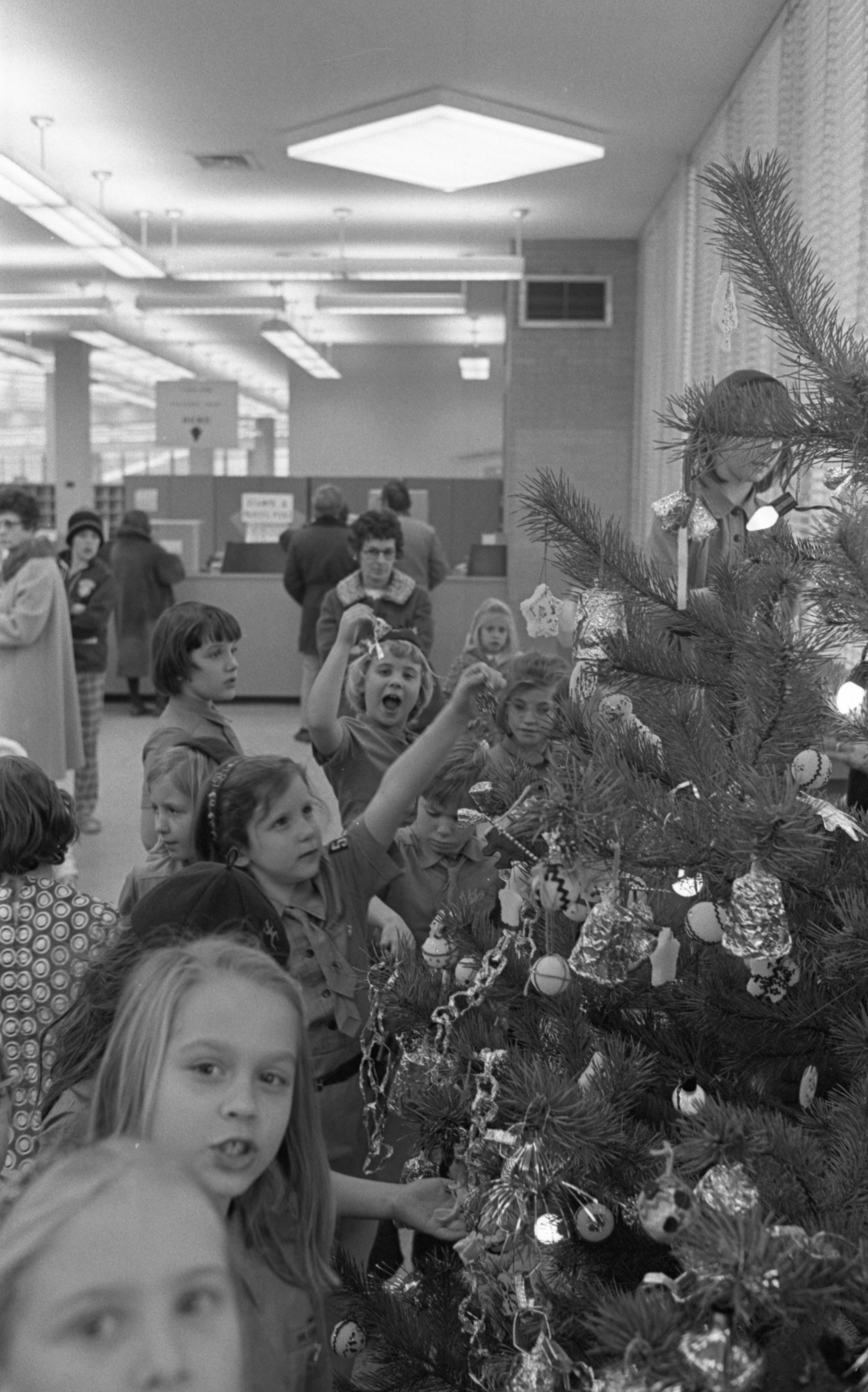 Lawton School Brownie Troops Decorate Christmas Tree At the Stadium Post Office, December 1970 image