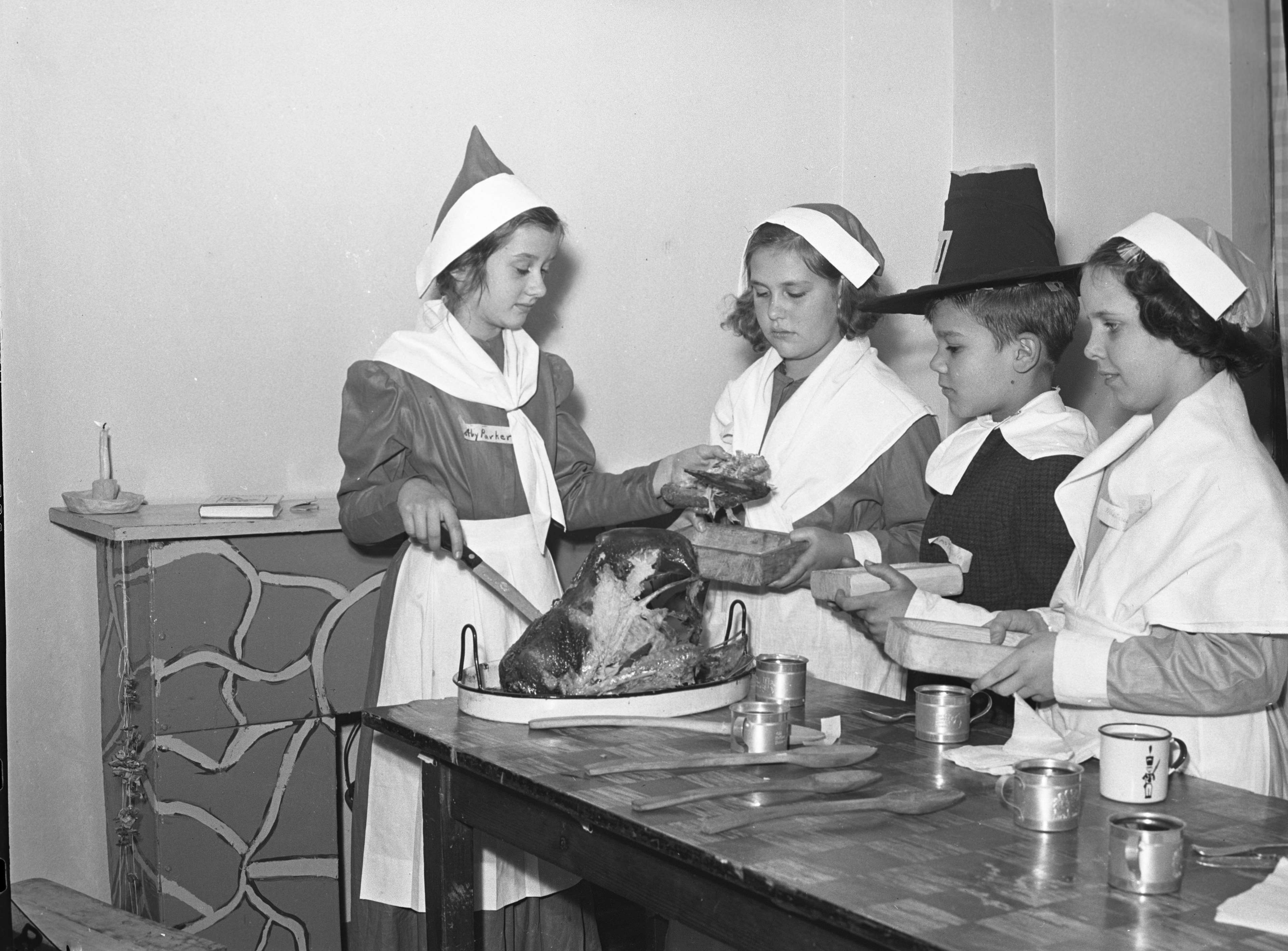 Mack School students have Thanksgiving dinner in pilgrim costumes, December 1939 image
