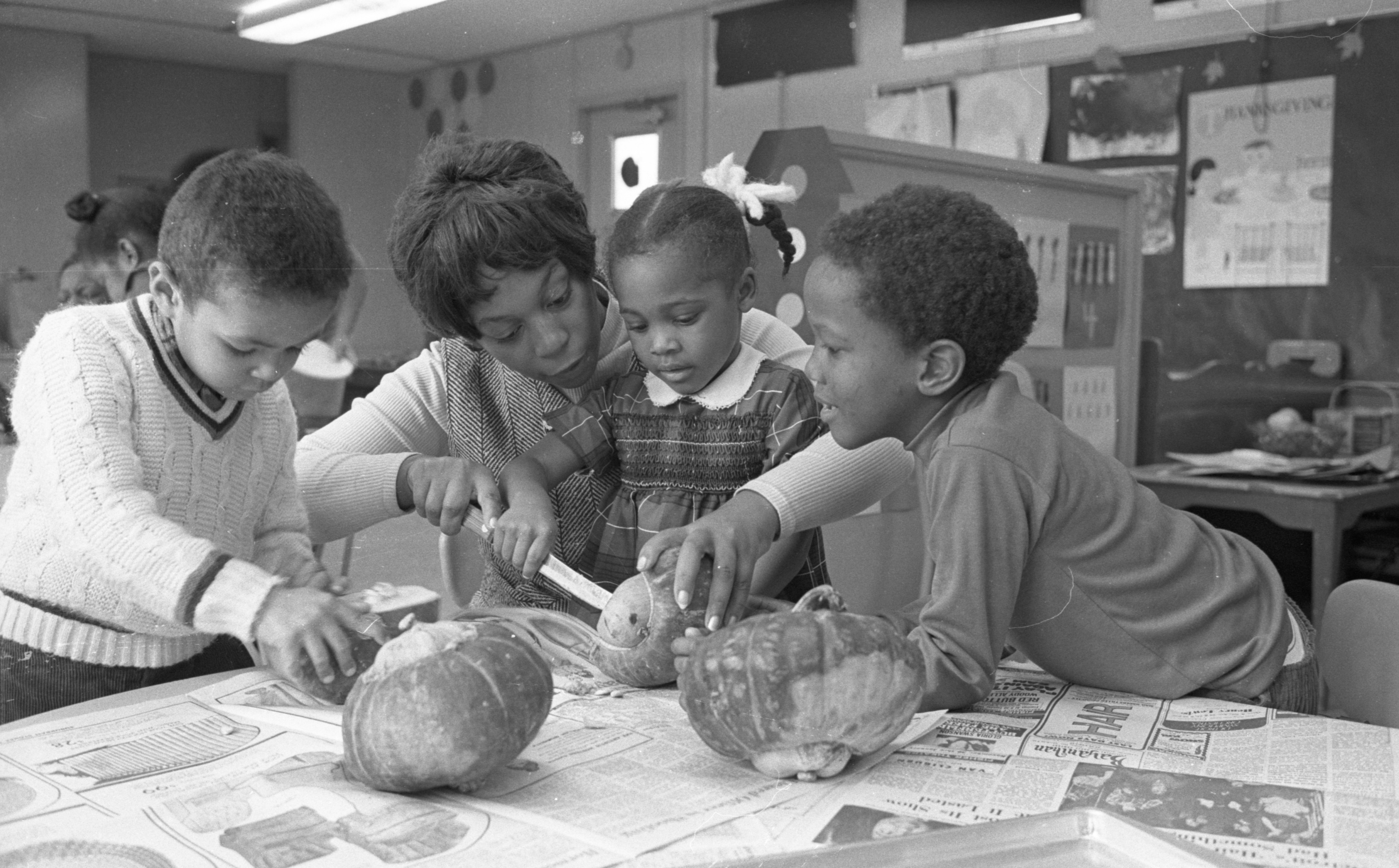 Earlene Hatley & Mack School Preschoolers Prepare Squash For A Thanksgiving Dinner, November 1970 image