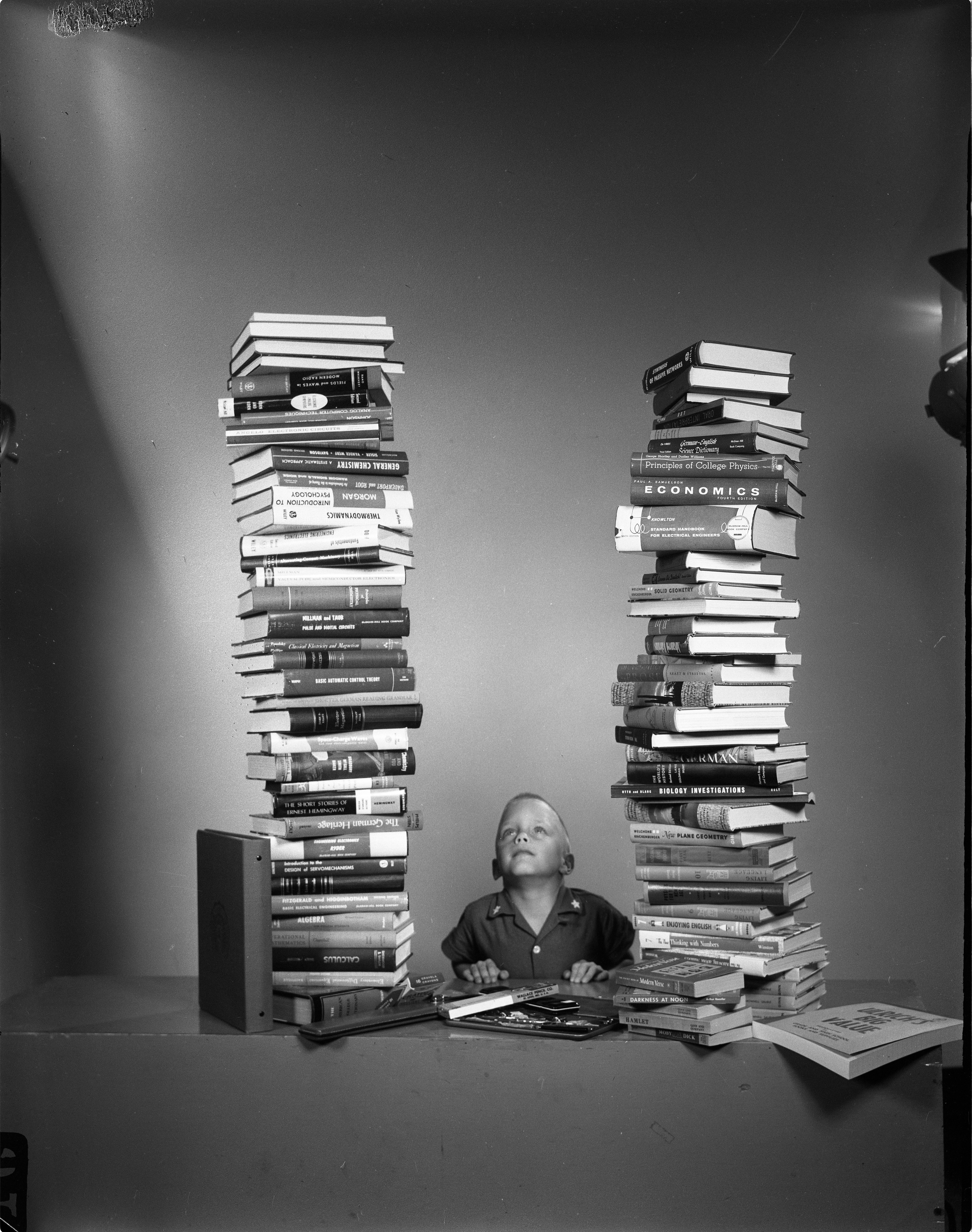 David DeLong Looks At Stack Of Textbooks, September 9, 1959 image