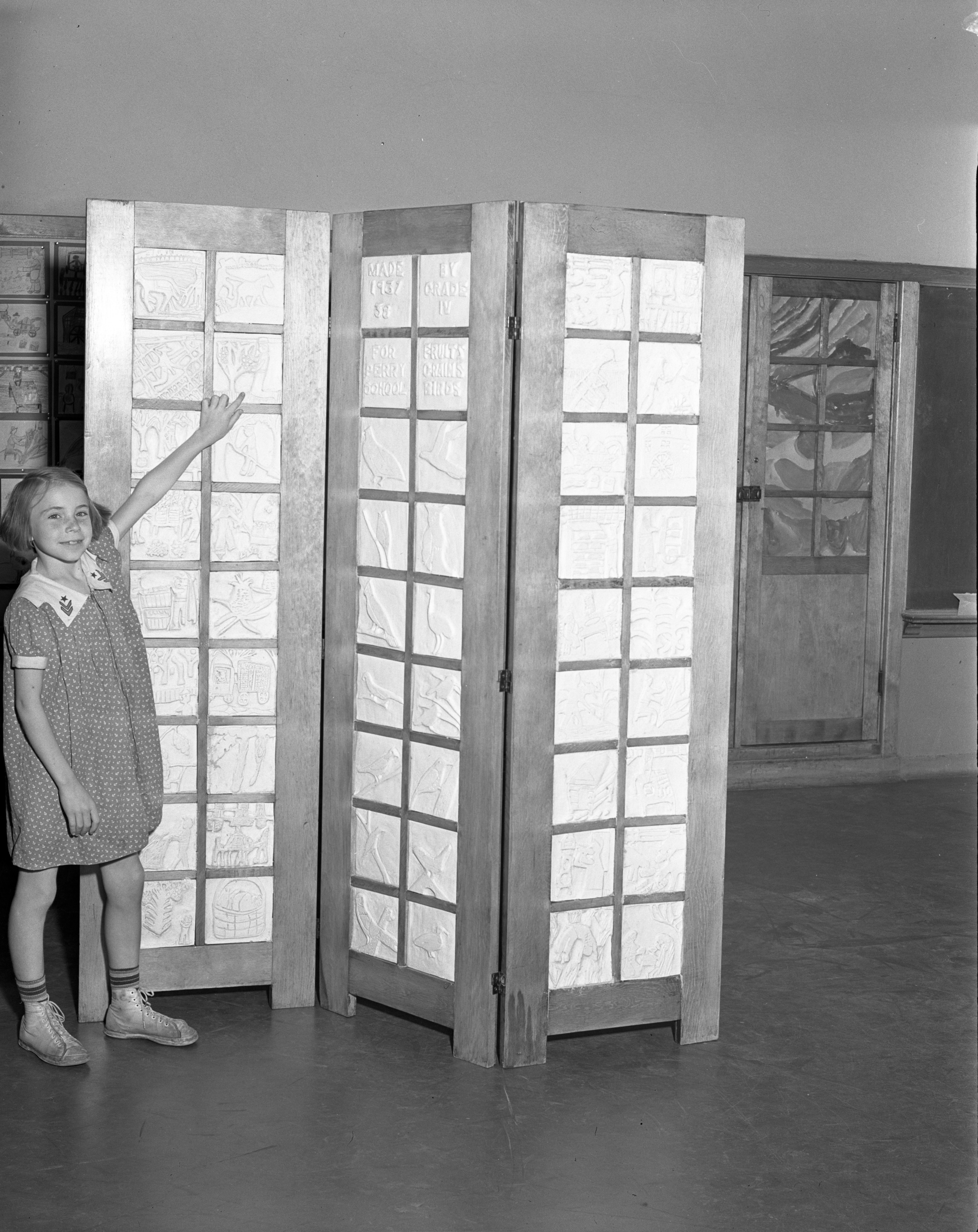 Perry School Fourth Grade Student Bernice Carpenter With Screen of Plaques, June 1938 image